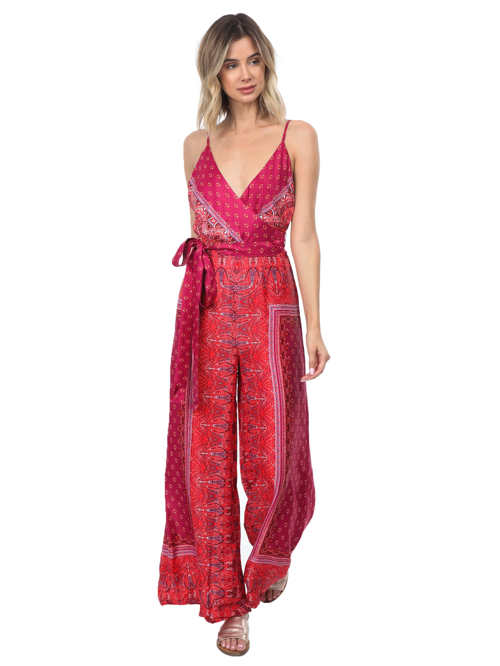Girl outfit in a jumpsuit rental from Free People called Cabbage Rose Jumpsuit