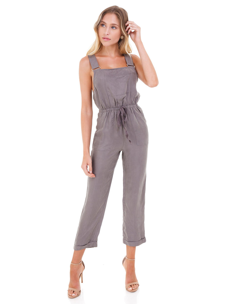 Women wearing a jumpsuit rental from FashionPass called Flutter Sleeve Wide Leg Jumpsuit