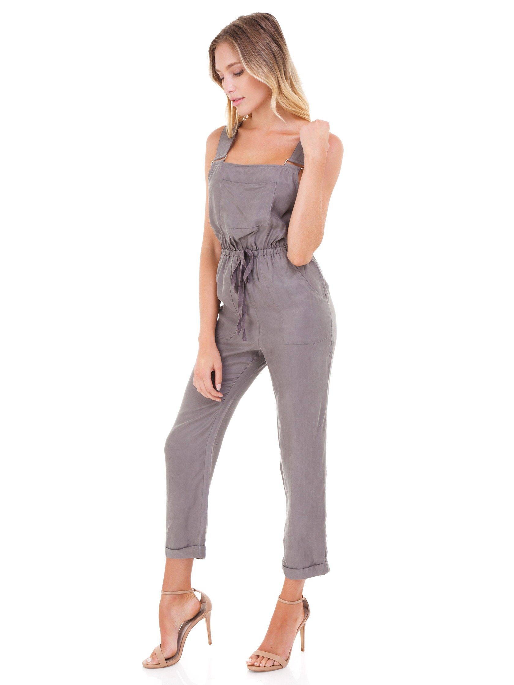 Woman wearing a jumpsuit rental from FashionPass called Cadie Overall