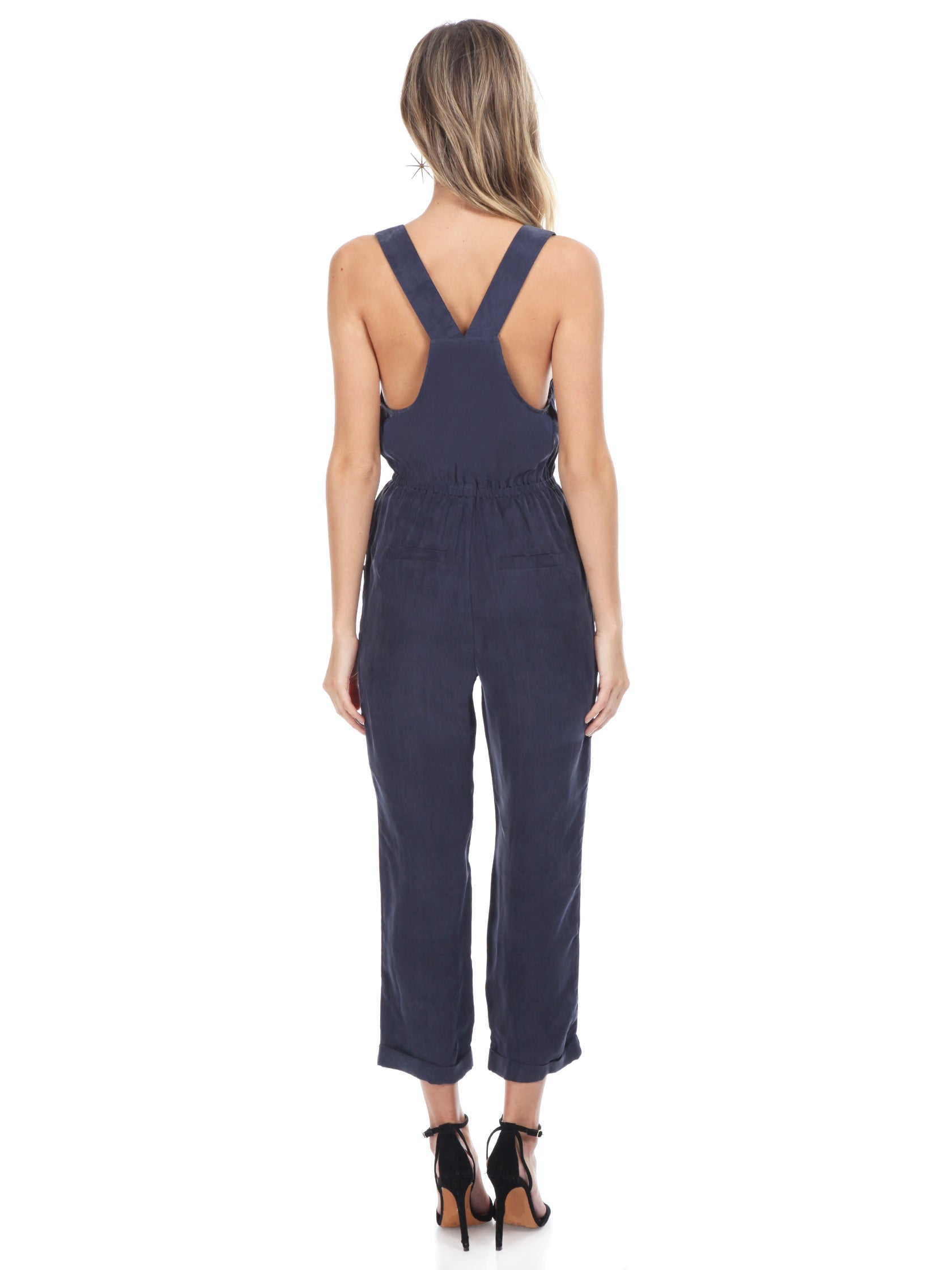 Women wearing a jumpsuit rental from FashionPass called Cadie Overall