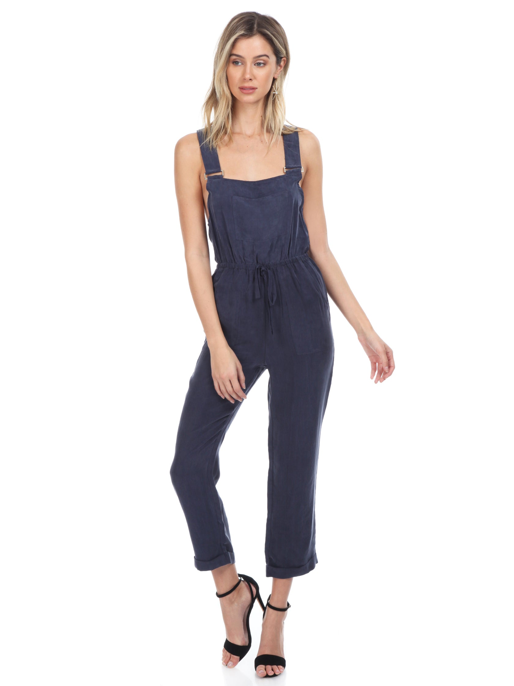 Women outfit in a jumpsuit rental from FashionPass called Cadie Overall