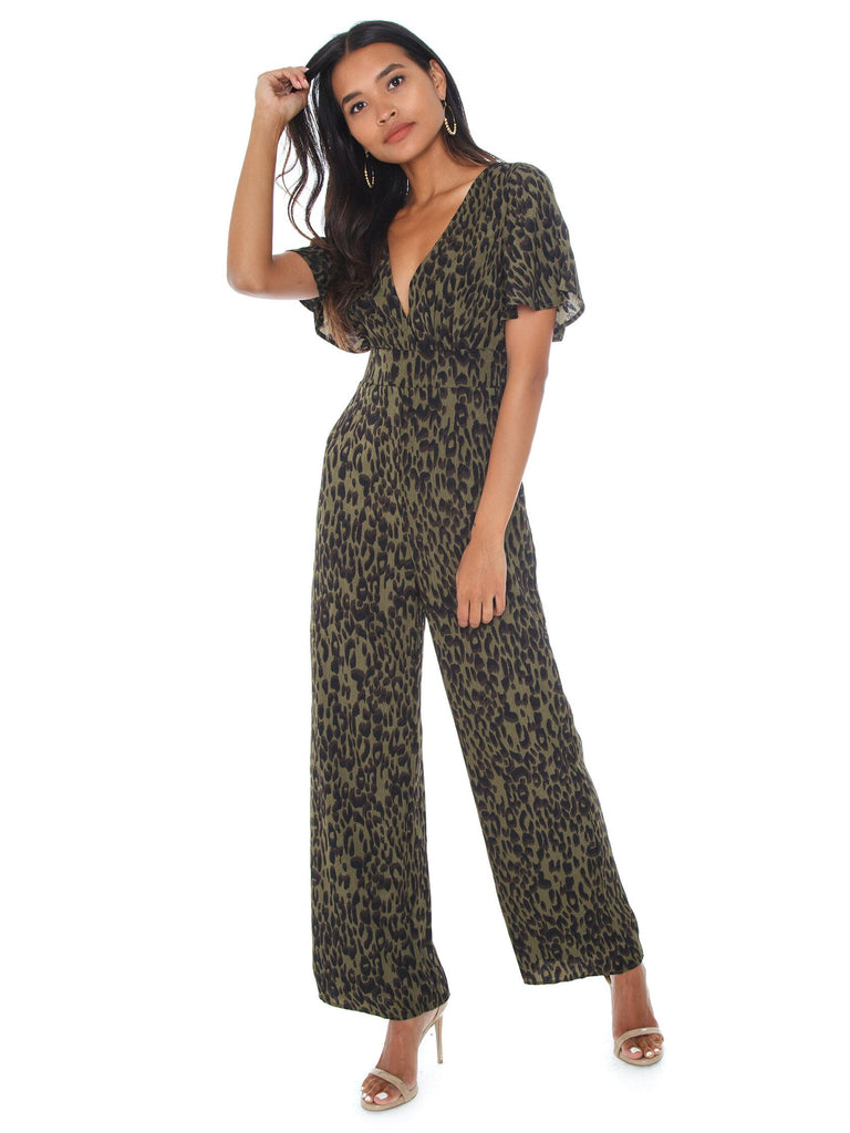 Women wearing a jumpsuit rental from Lost In Lunar called Allira Maxi Dress