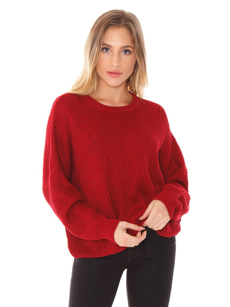 Women wearing a sweater rental from FashionPass called Ruffle Sleeve Striped Sweater