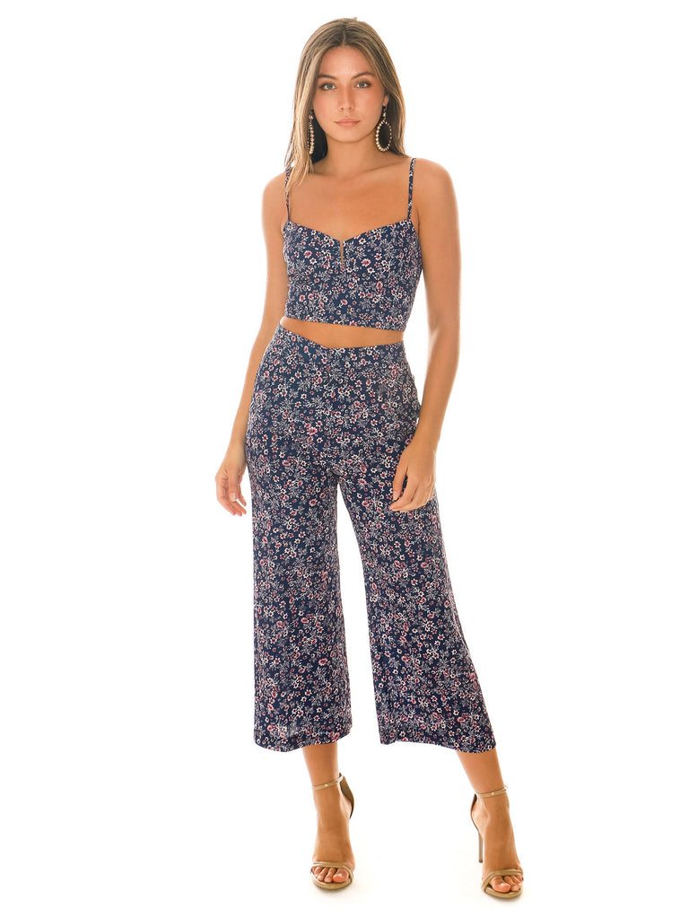 Women outfit in a pants rental from Blue Life called Stripe Cropped Jumpsuit