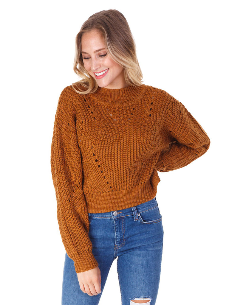 Woman wearing a sweater rental from ASTR called Shae Top