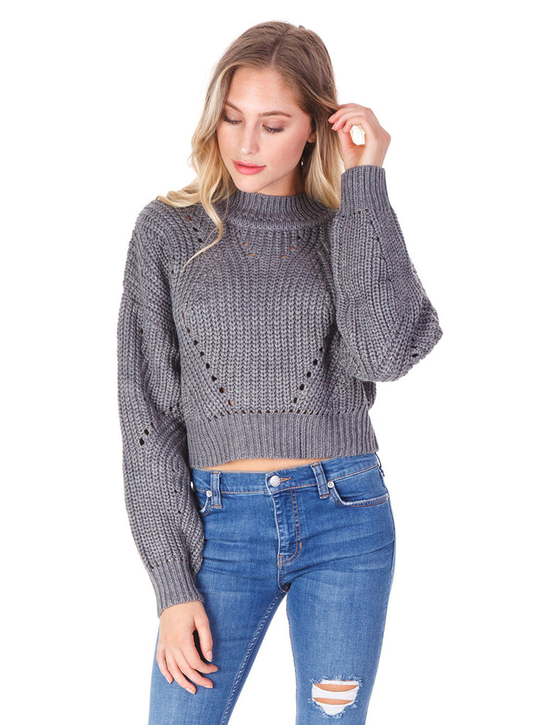 Women outfit in a sweater rental from ASTR called Scrunched Up Off Shoulder Bikini Top