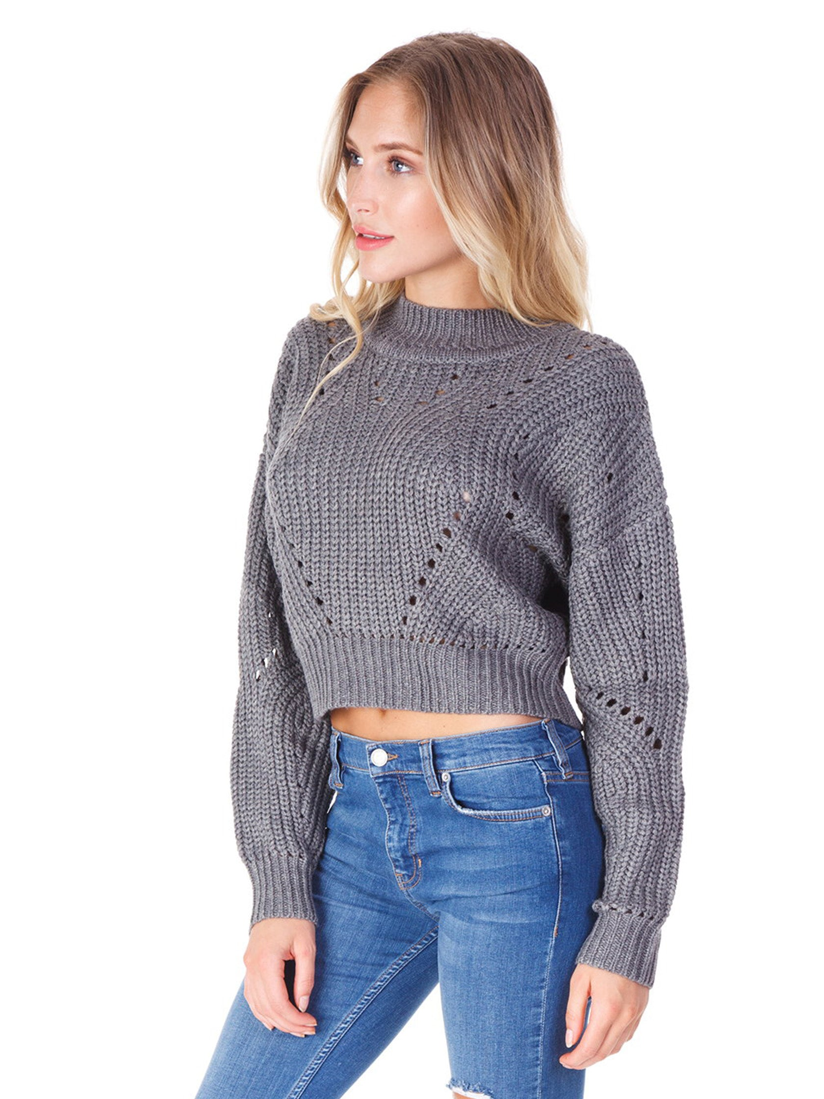 Women wearing a sweater rental from ASTR called Carly Sweater