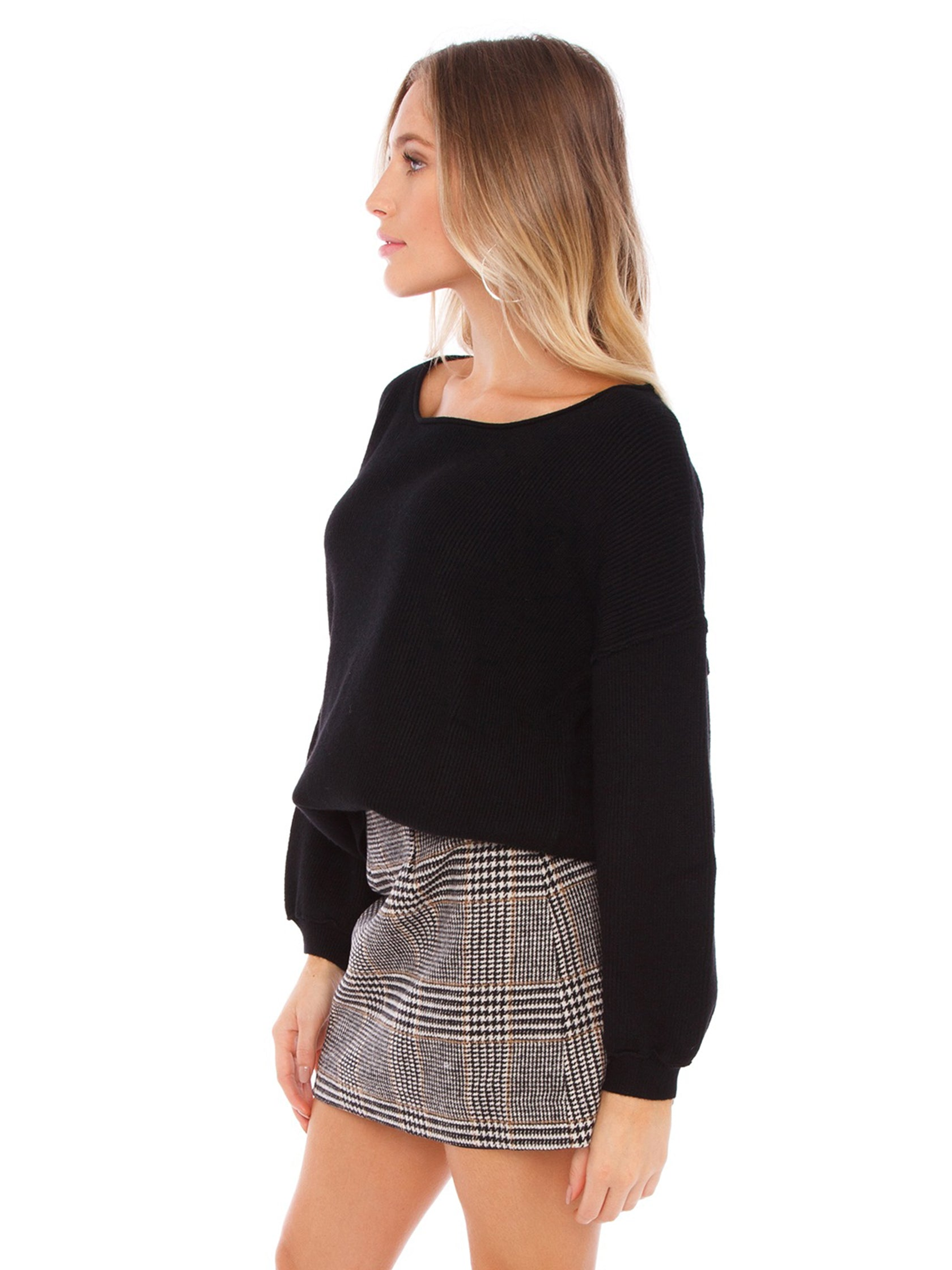 Women wearing a sweater rental from FashionPass called Cece Sweater