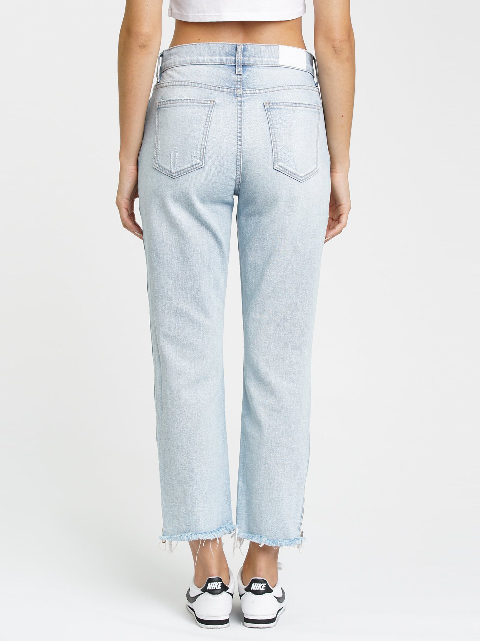 Women wearing a denim rental from PISTOLA called Charlie High Rise Jeans