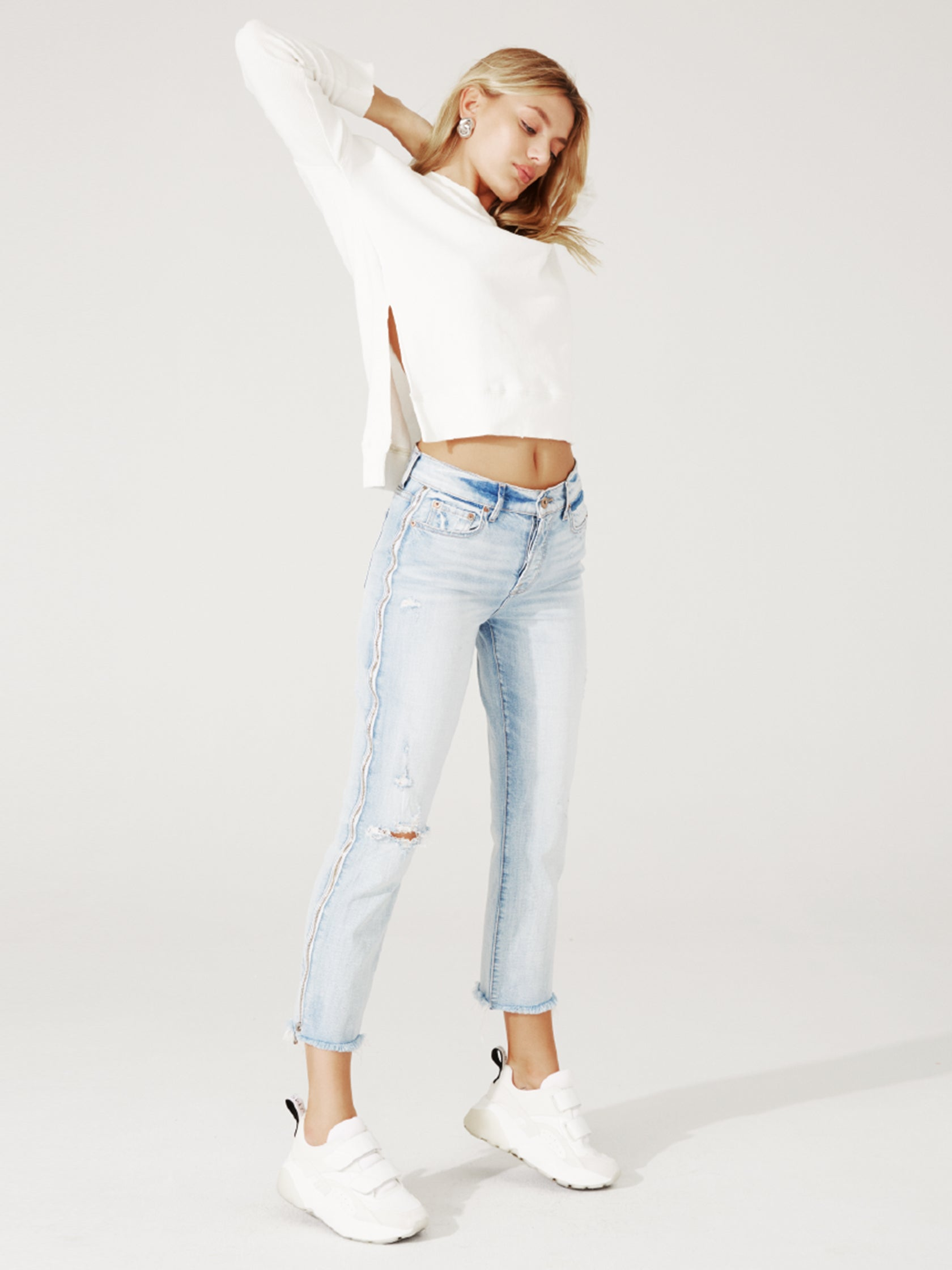 Woman wearing a denim rental from PISTOLA called Charlie High Rise Jeans