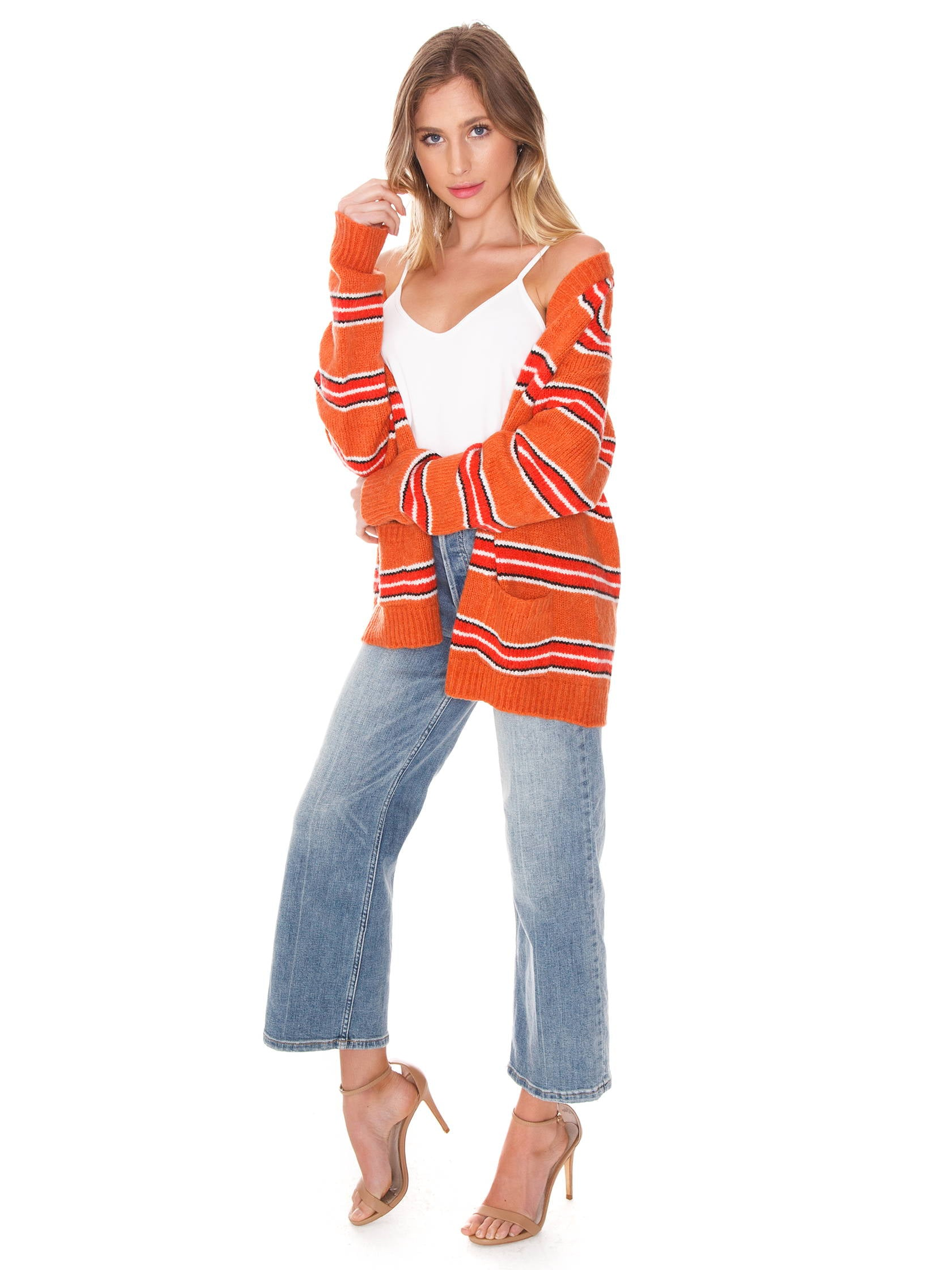 fe3274e6c25 Woman wearing a sweater rental from For Love   Lemons called Charlie Striped  Sweater
