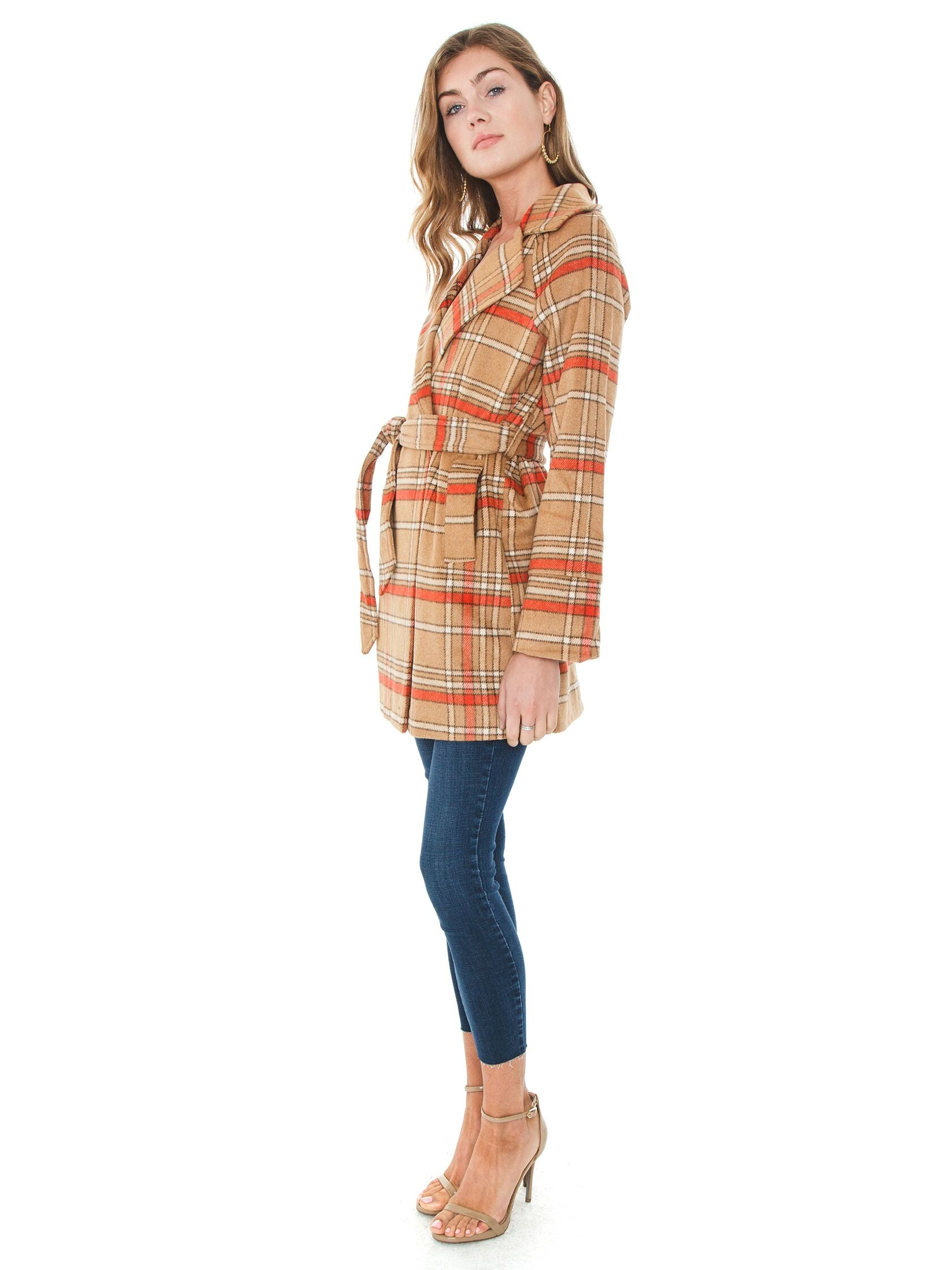 Woman wearing a jacket rental from MINKPINK called Check Coat