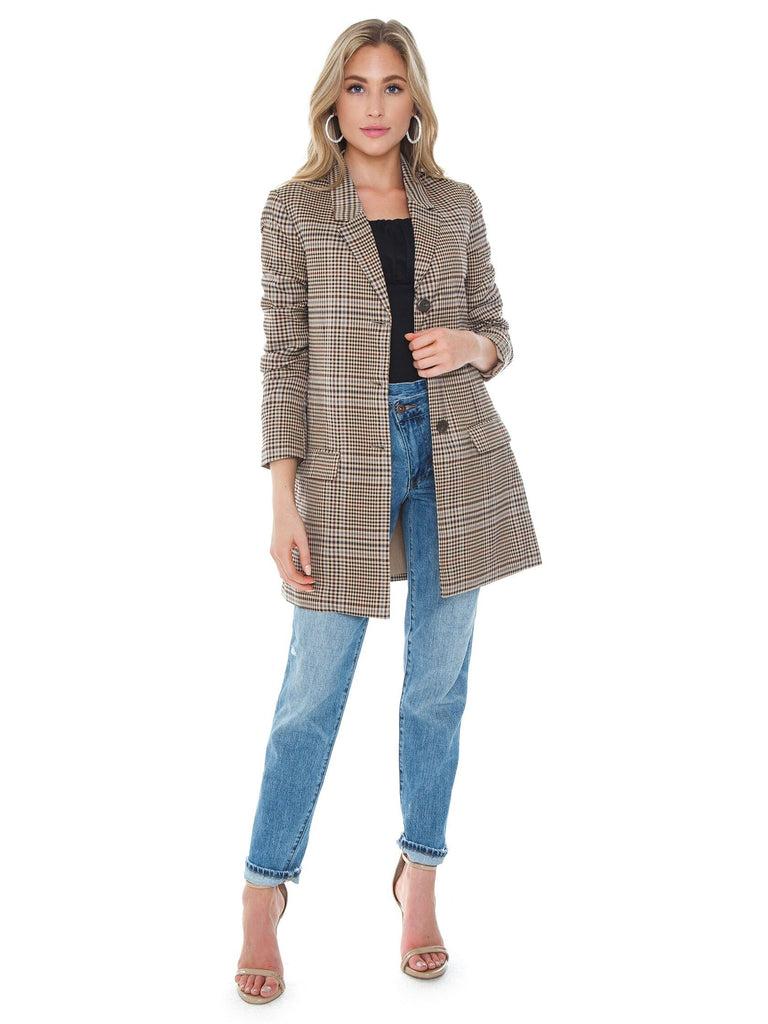 Woman wearing a blazer rental from BB Dakota called Soft Skills Faux Fur Jacket