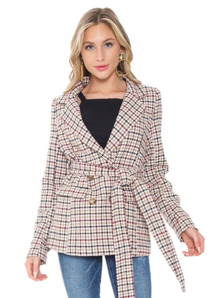 Woman wearing a blazer rental from Line & Dot called Faux Fur Jacket
