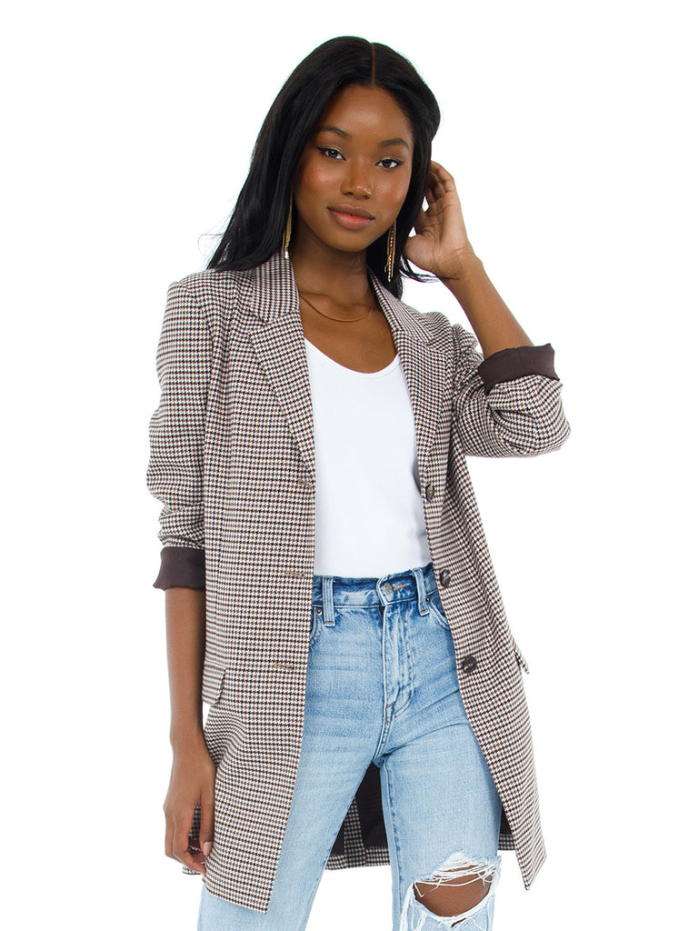 Woman wearing a blazer rental from BB Dakota called Dillon Mini Skirt