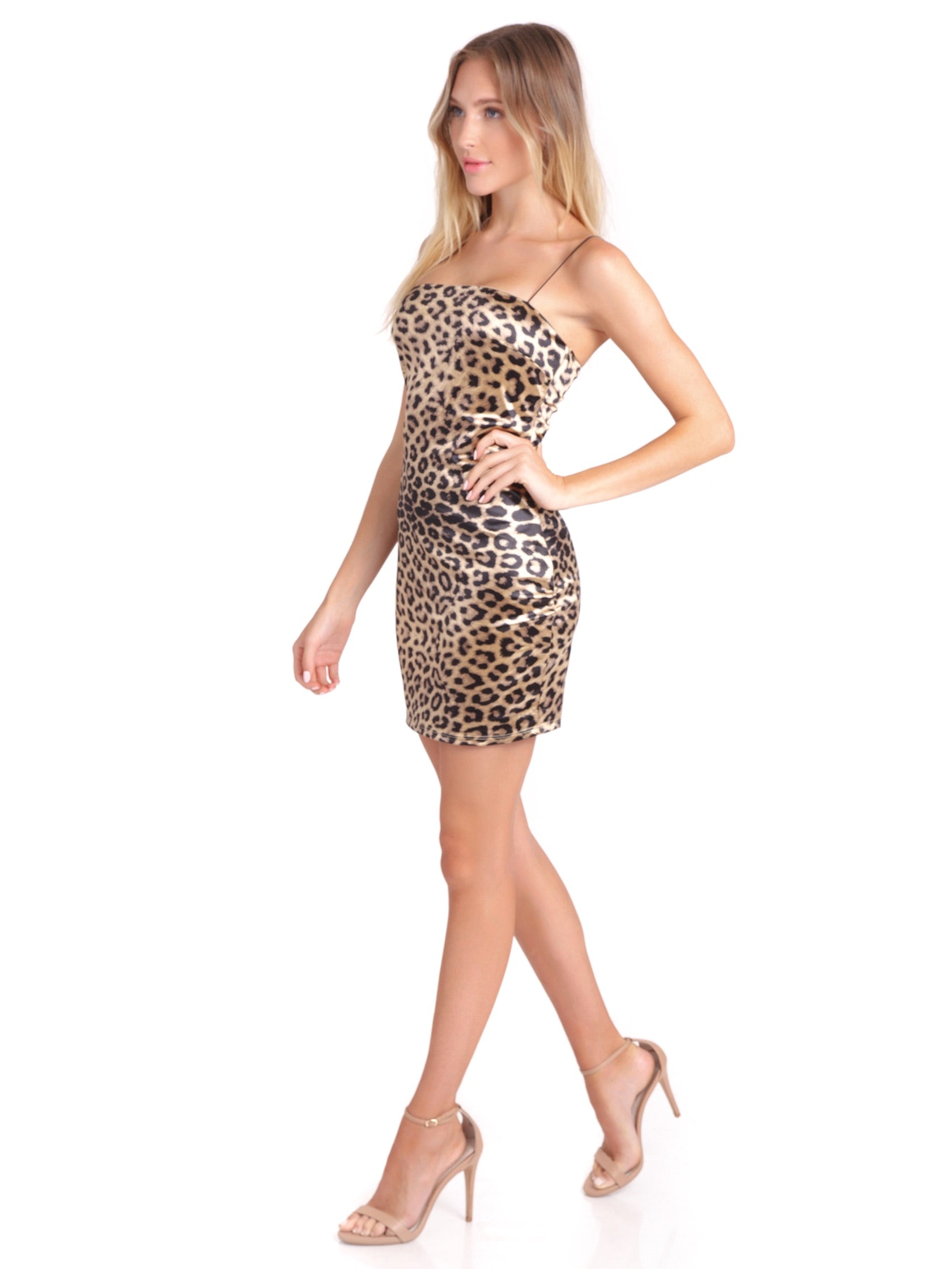 Woman wearing a dress rental from FashionPass called Cheetah Girl Mini Dress