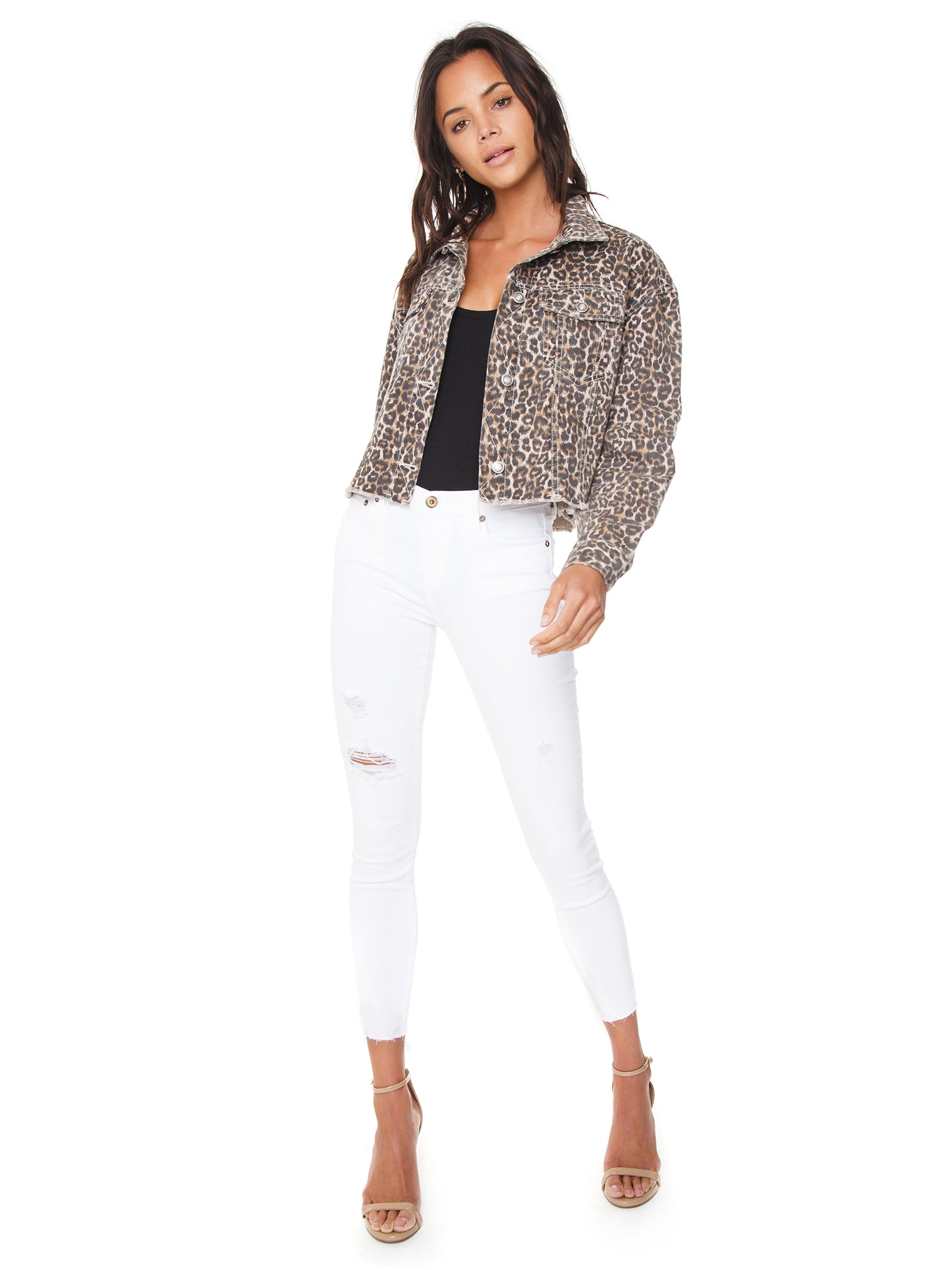 Girl wearing a jacket rental from Free People called Cheetah Printed Denim Jacket