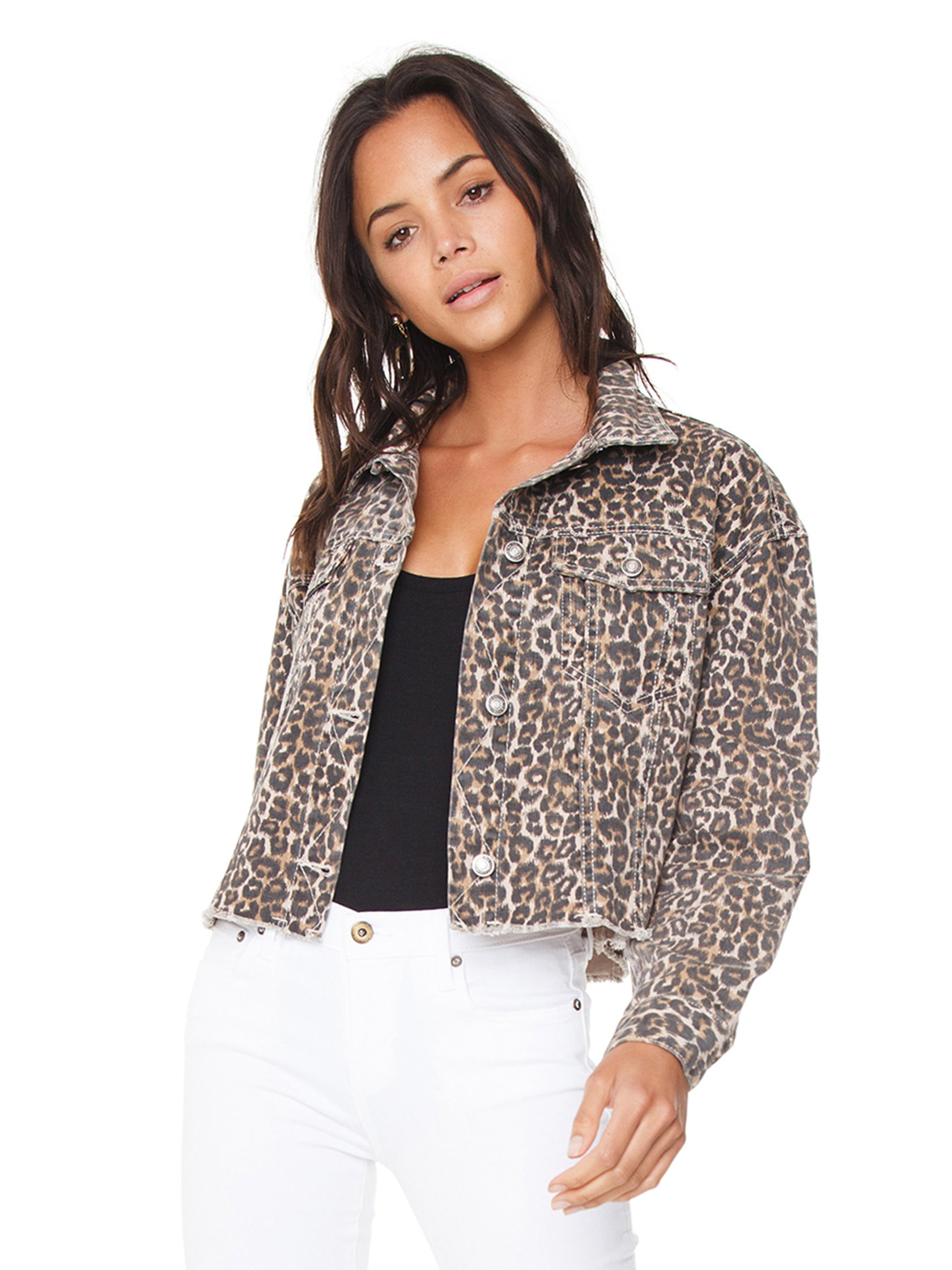 Woman wearing a jacket rental from Free People called Cheetah Printed Denim Jacket