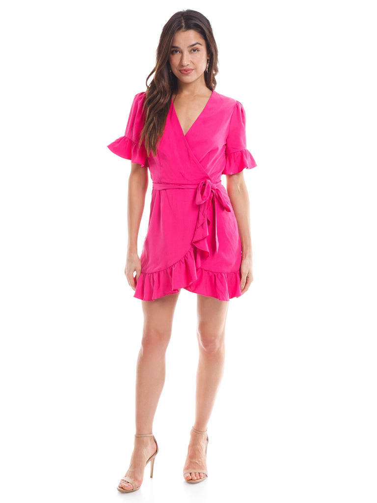 Girl outfit in a dress rental from Line & Dot called Elsie Ruffle Wrap Dress