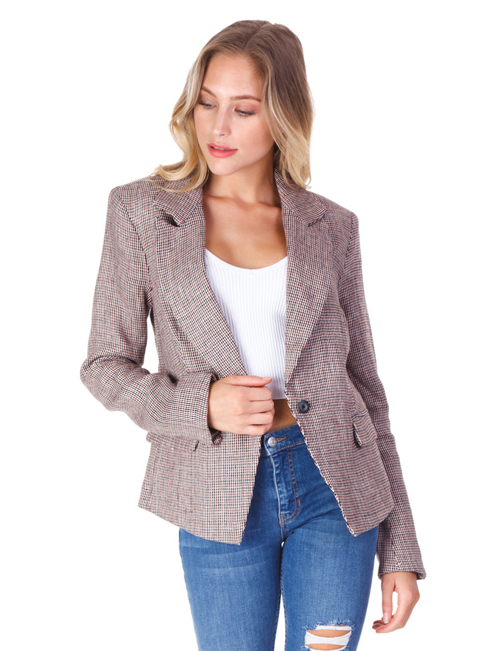 Woman wearing a blazer rental from Free People called Chess Blazer