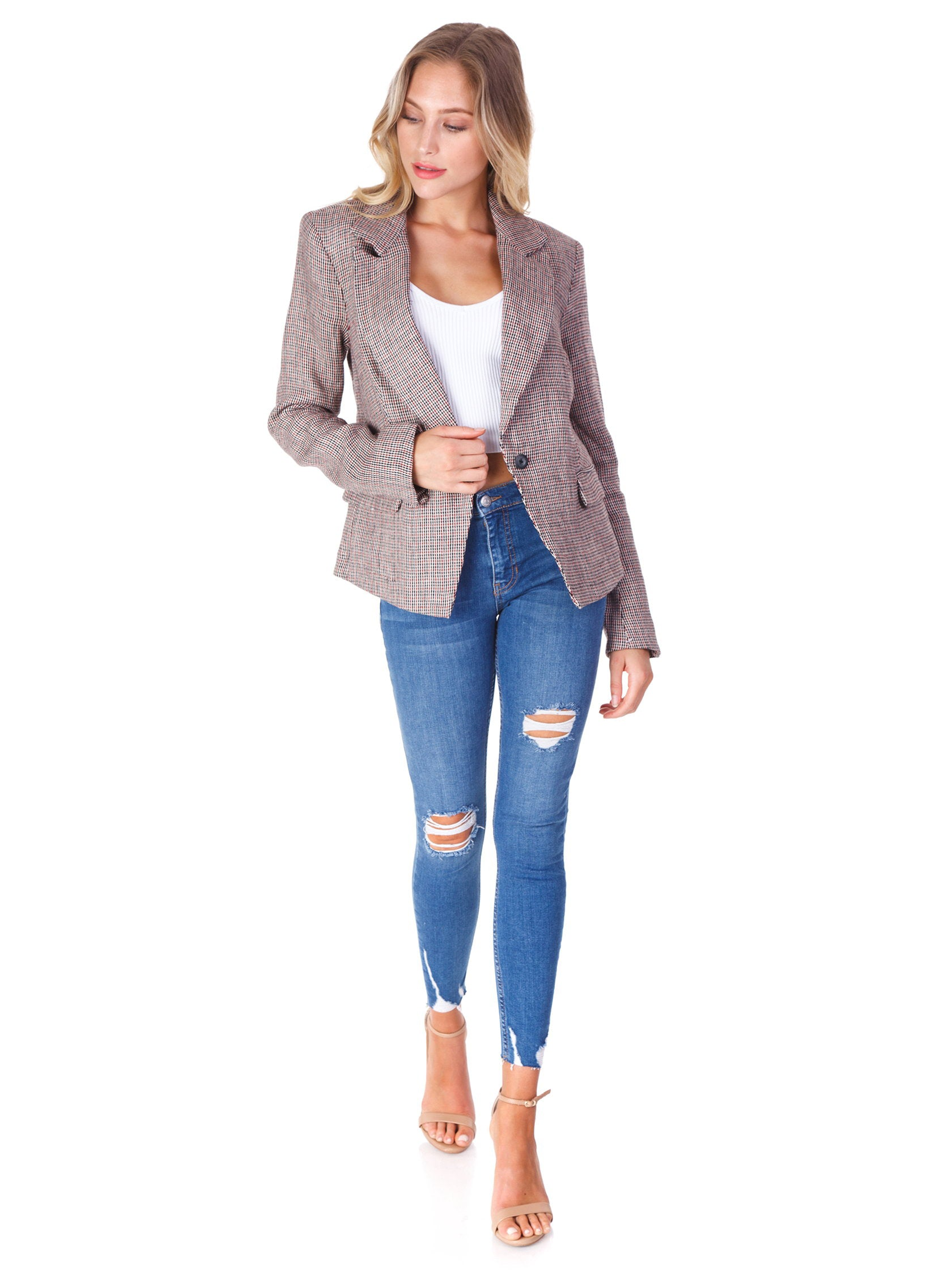 Girl wearing a blazer rental from Free People called Chess Blazer