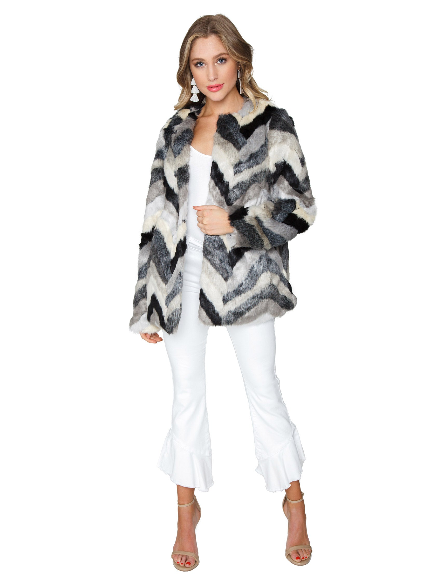 Girl wearing a jacket rental from FashionPass called Chevron Faux Fur Jacket