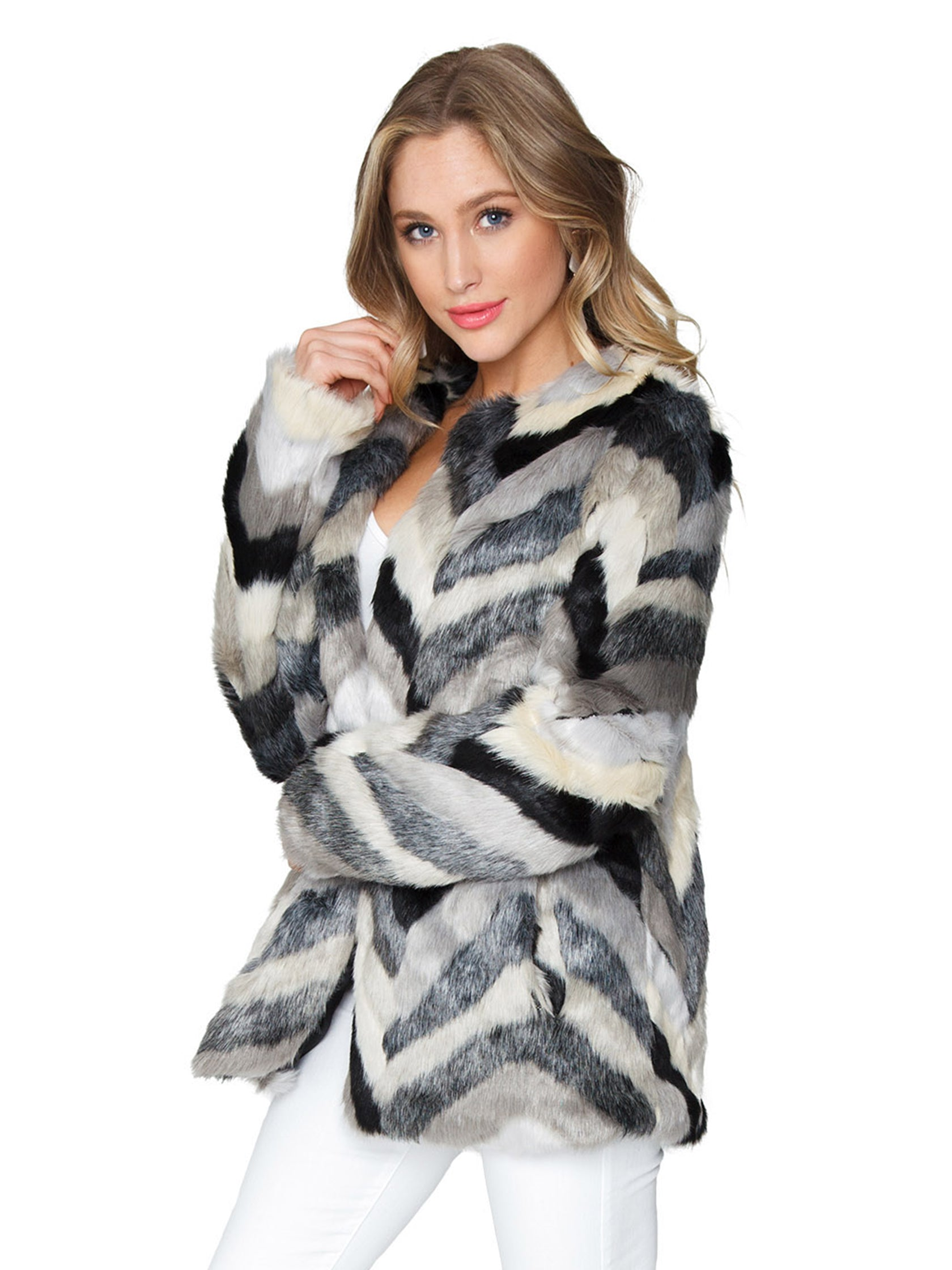 Women wearing a jacket rental from FashionPass called Chevron Faux Fur Jacket