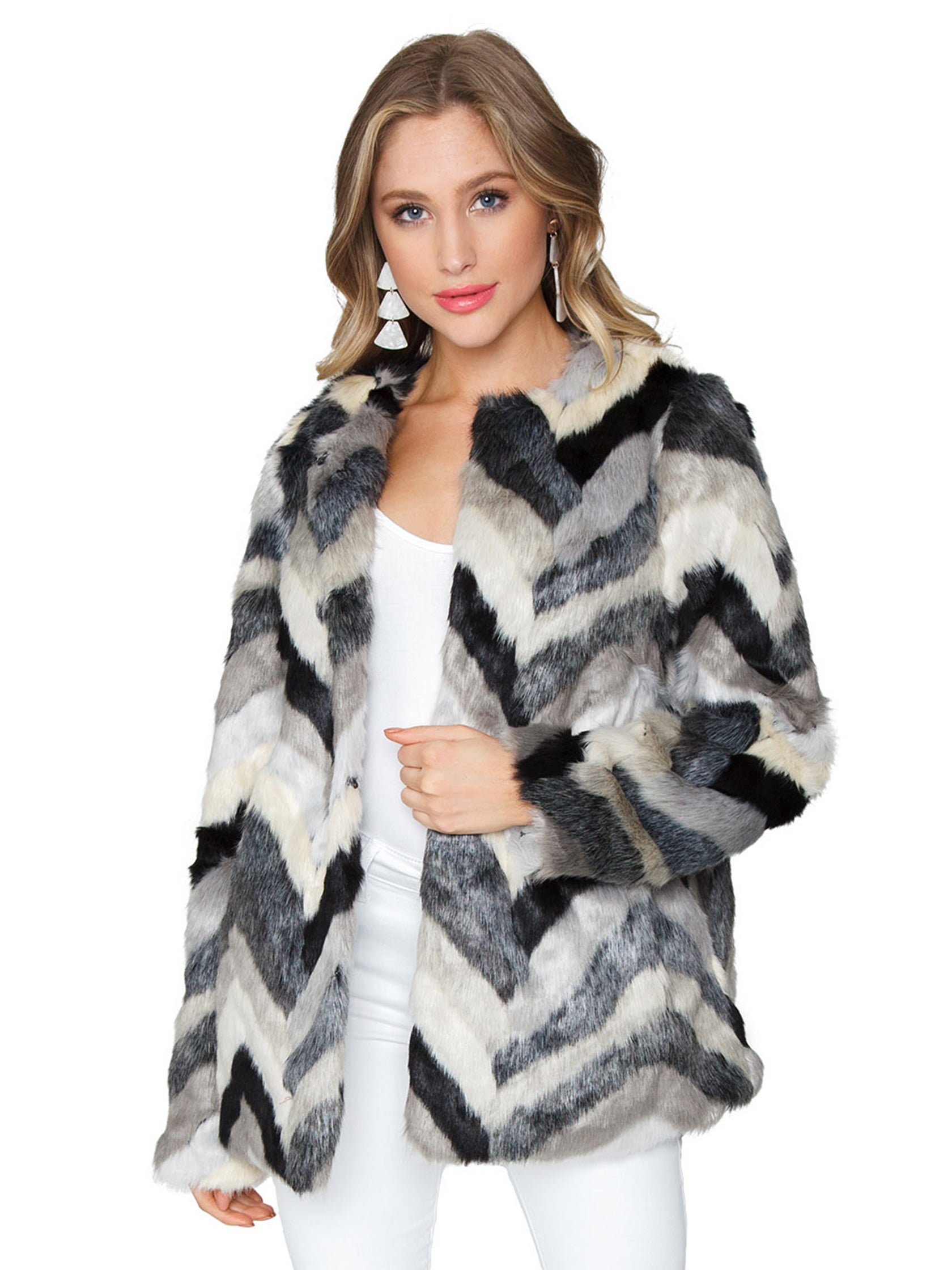 Woman wearing a jacket rental from FashionPass called Chevron Faux Fur Jacket