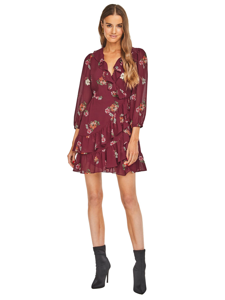 Girl outfit in a dress rental from ASTR called Brynn Deep Plunge Dress