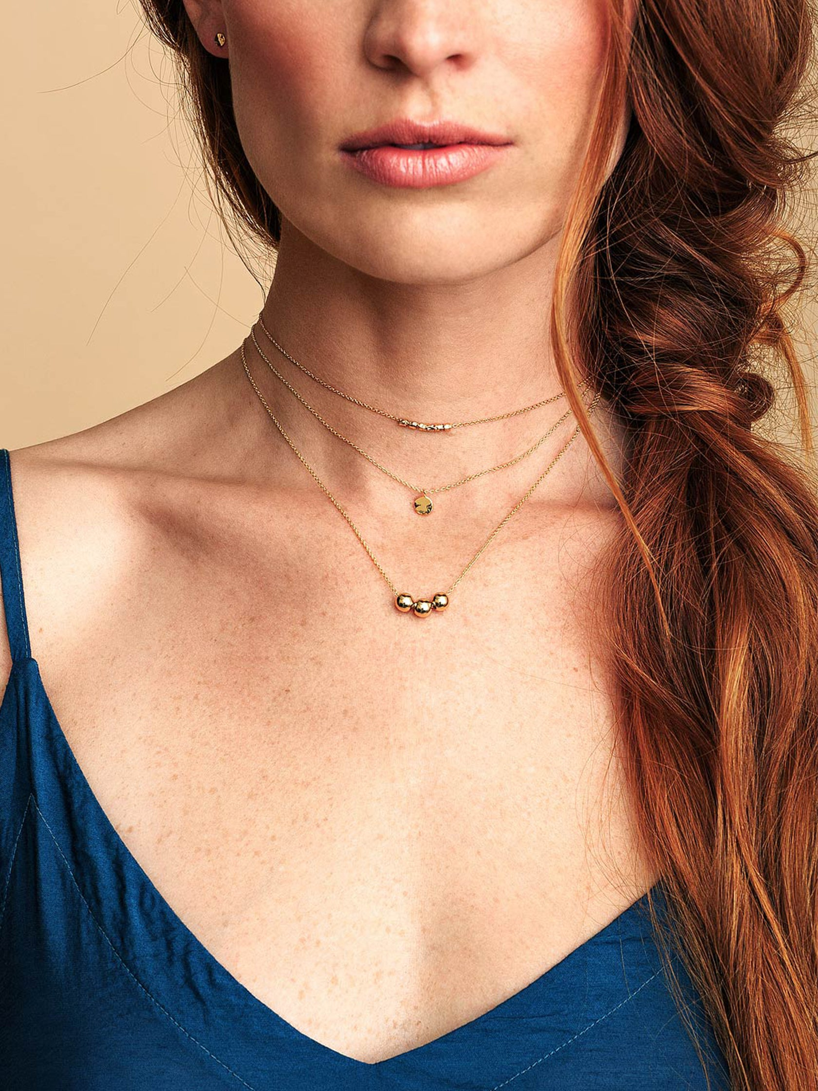Woman wearing a necklace rental from Gorjana called Chloe Charm Adjustable Necklace
