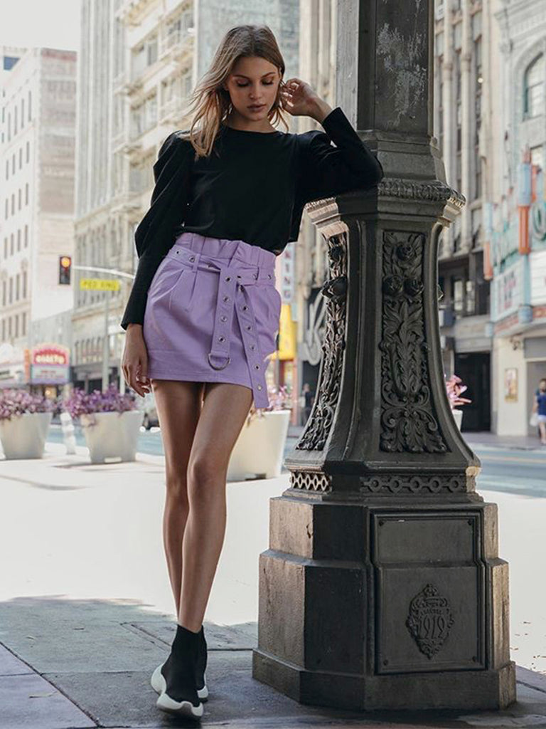Women wearing a skirt rental from FashionPass called Chloe Mini Skirt
