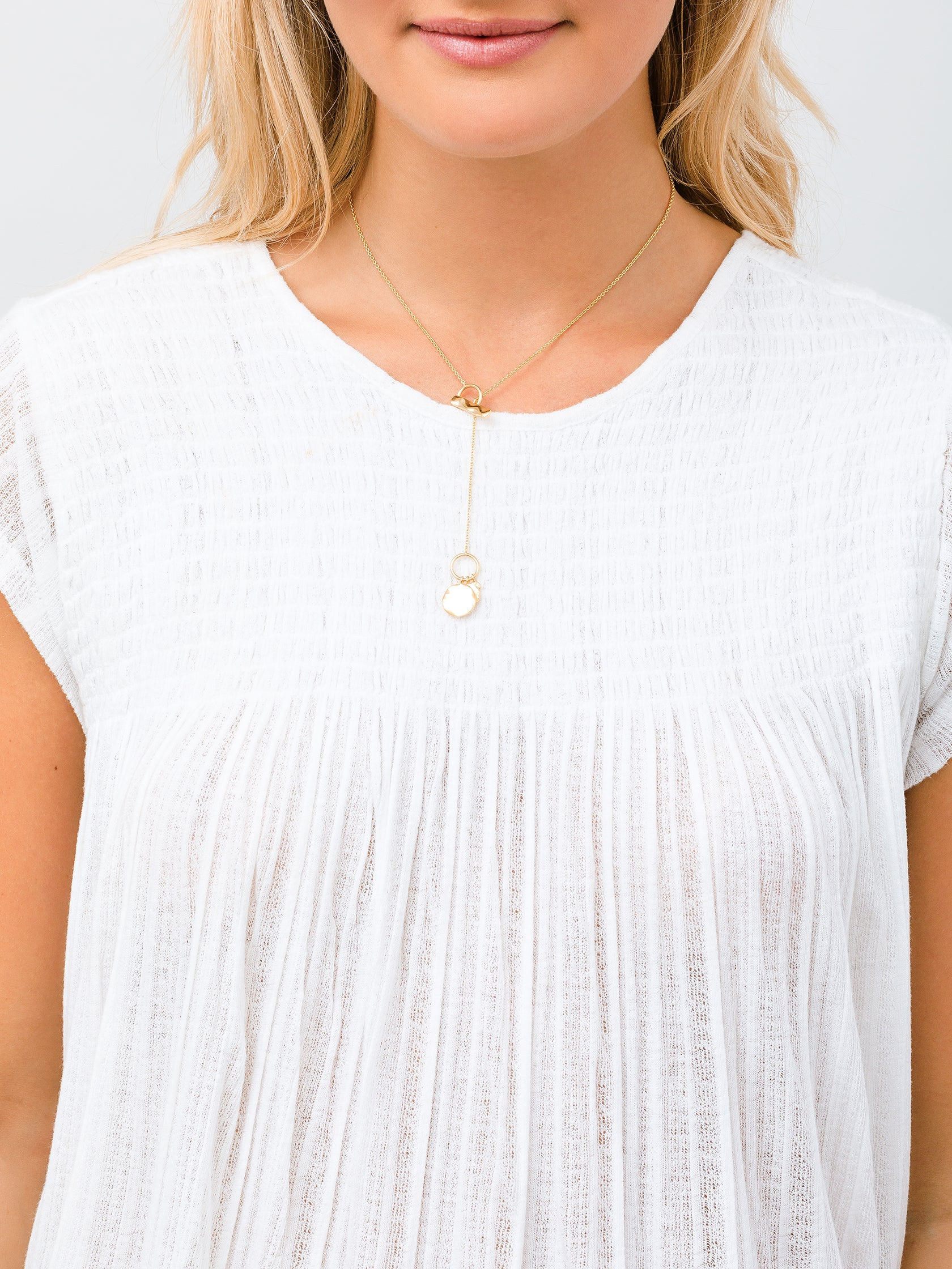 Women wearing a necklace rental from Gorjana called Chloe Small Toggle Versatile Necklace
