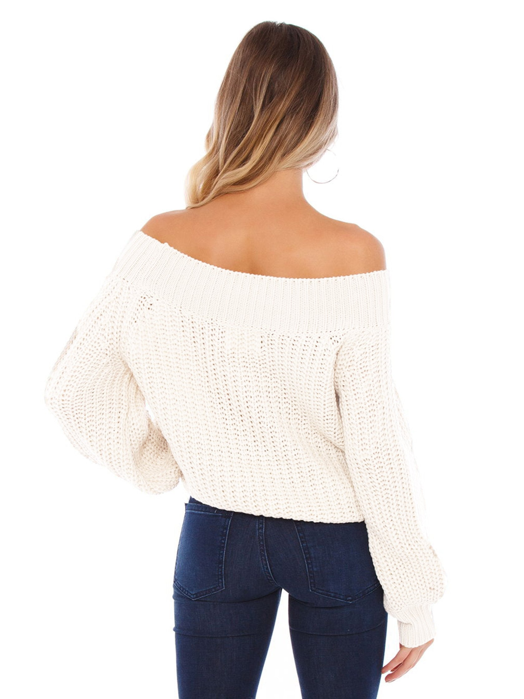 Women wearing a sweater rental from FASHIONPASS called Chrissy Off Shoulder Sweater
