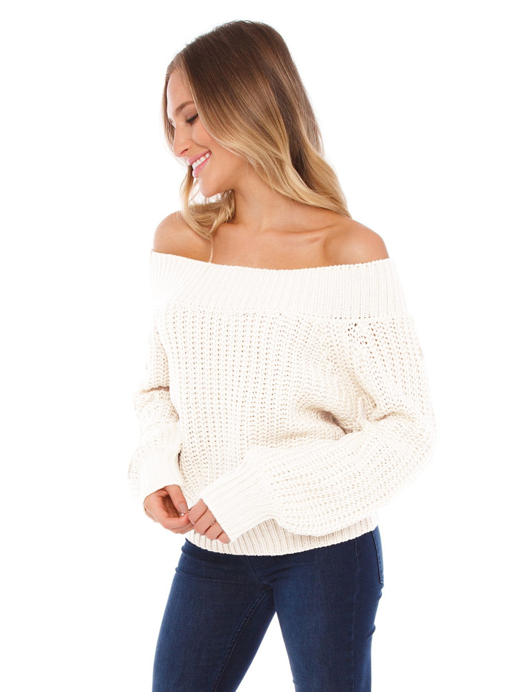 Woman wearing a sweater rental from FASHIONPASS called Chrissy Off Shoulder Sweater