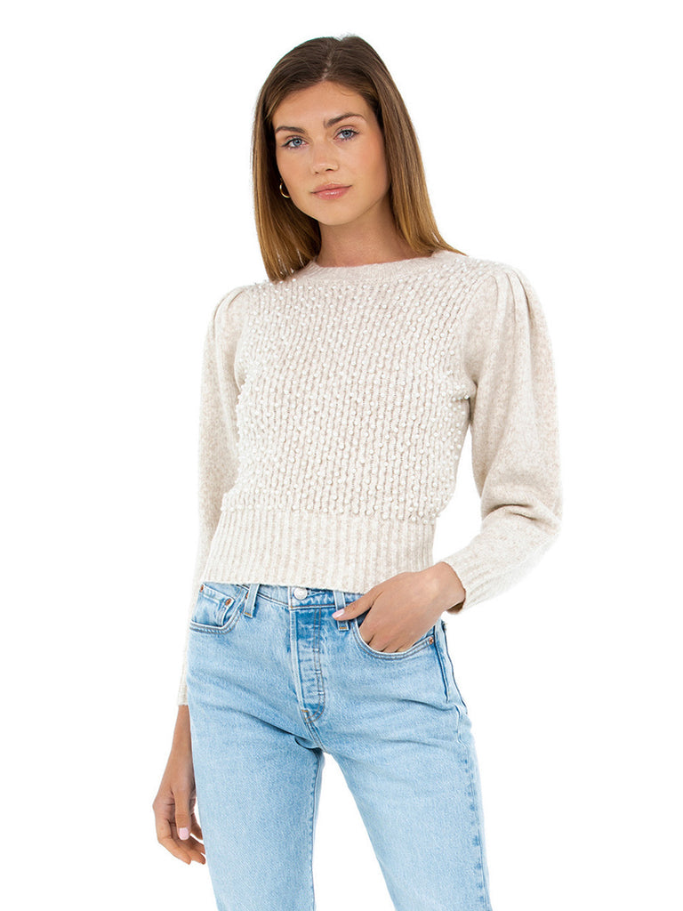 Girl wearing a sweater rental from ASTR called Double Crossed Knit