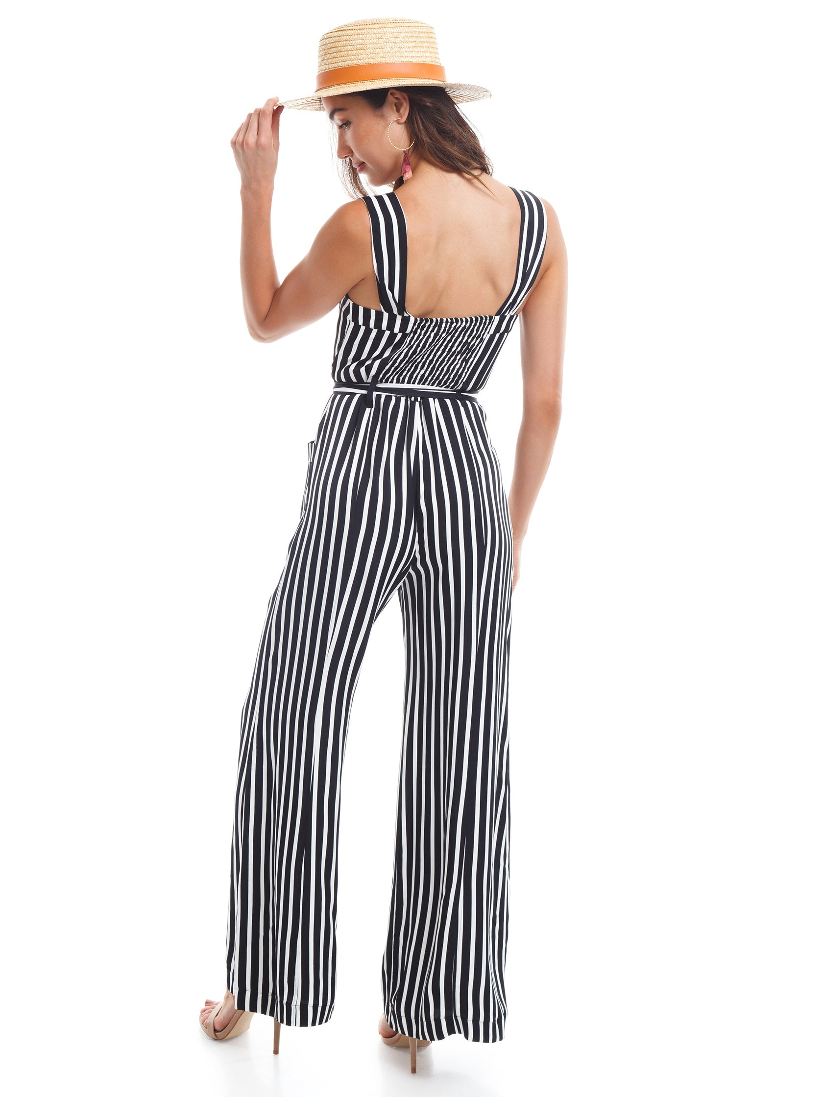 Women wearing a jumpsuit rental from Free People called City Girl Jumpsuit