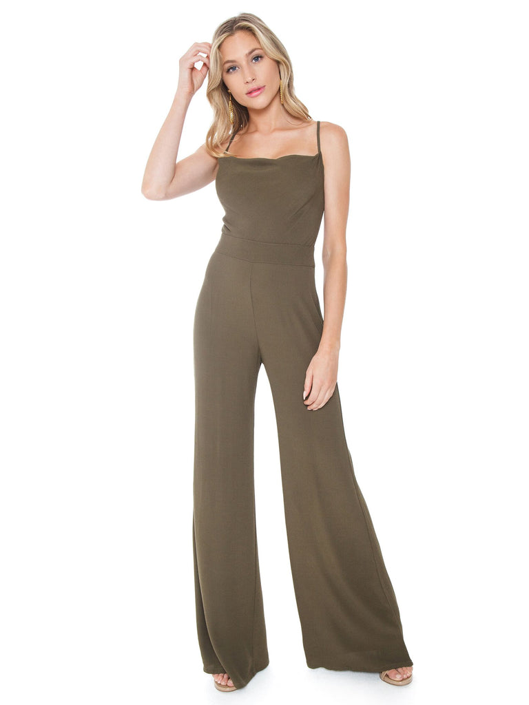 Women wearing a jumpsuit rental from Flynn Skye called Zion Jumpsuit