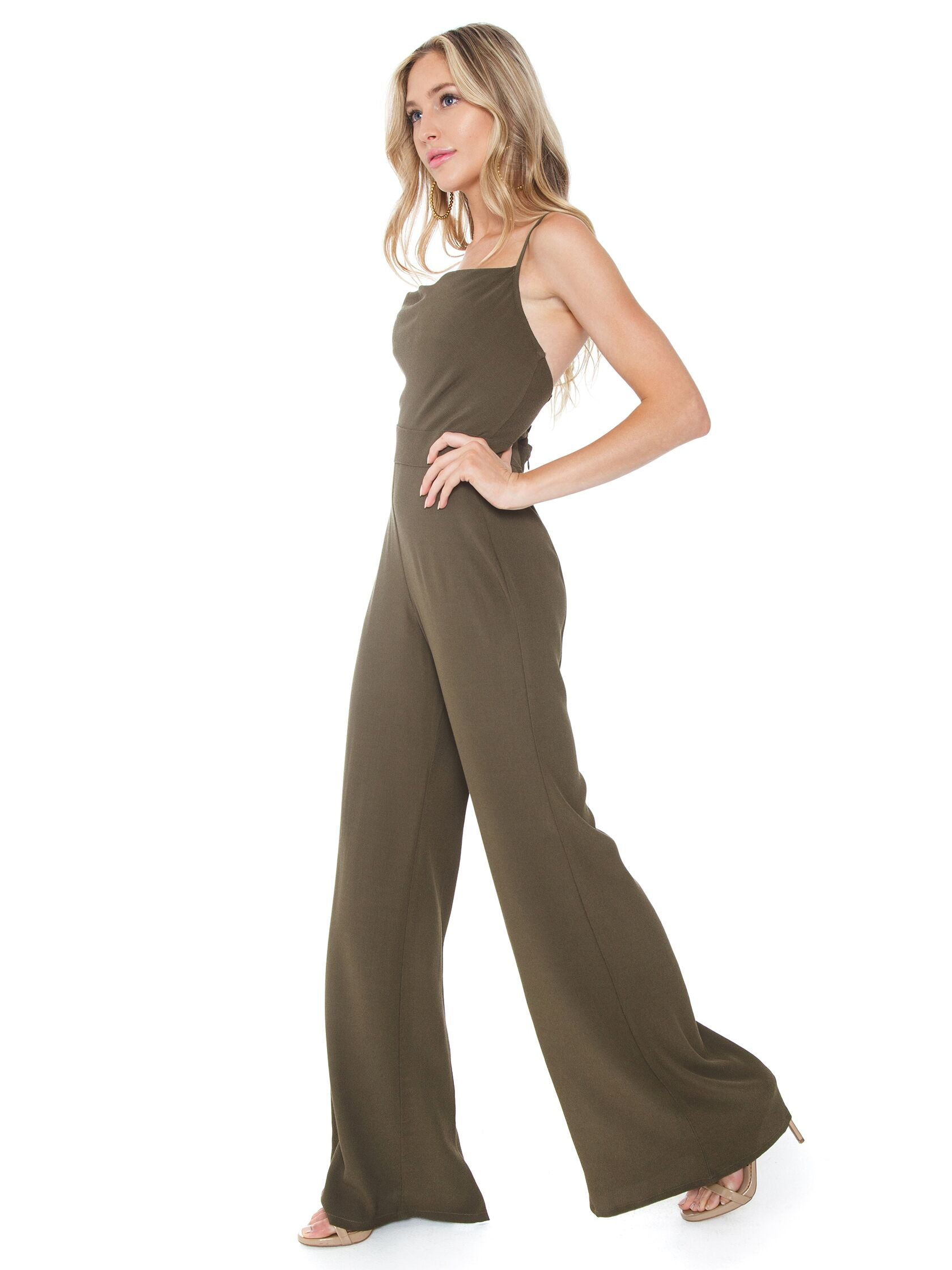 Woman wearing a jumpsuit rental from Flynn Skye called Coco Jumper