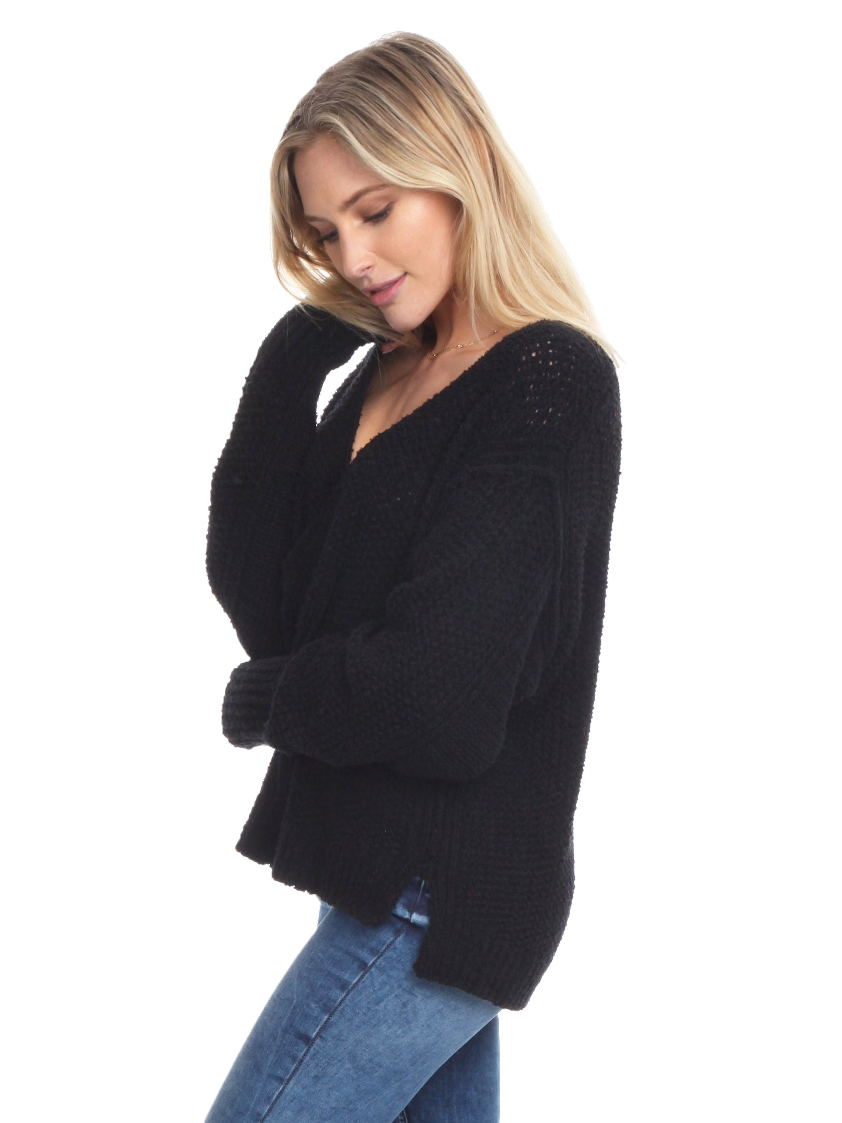 Women wearing a sweater rental from Free People called Coco V Neck Sweater