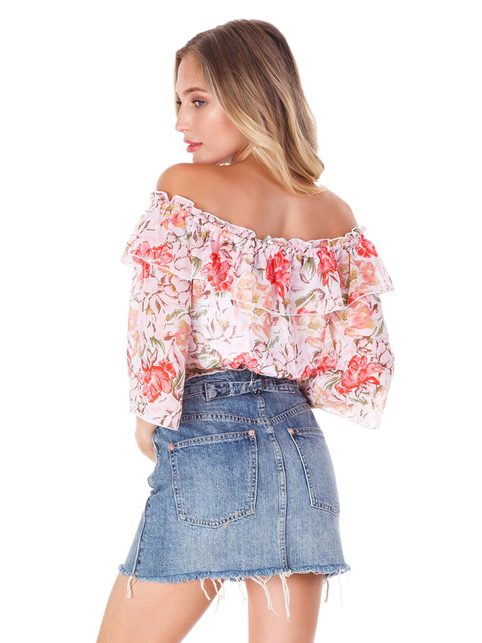Women outfit in a top rental from WAYF called Cosenza Off Shoulder Crop Top