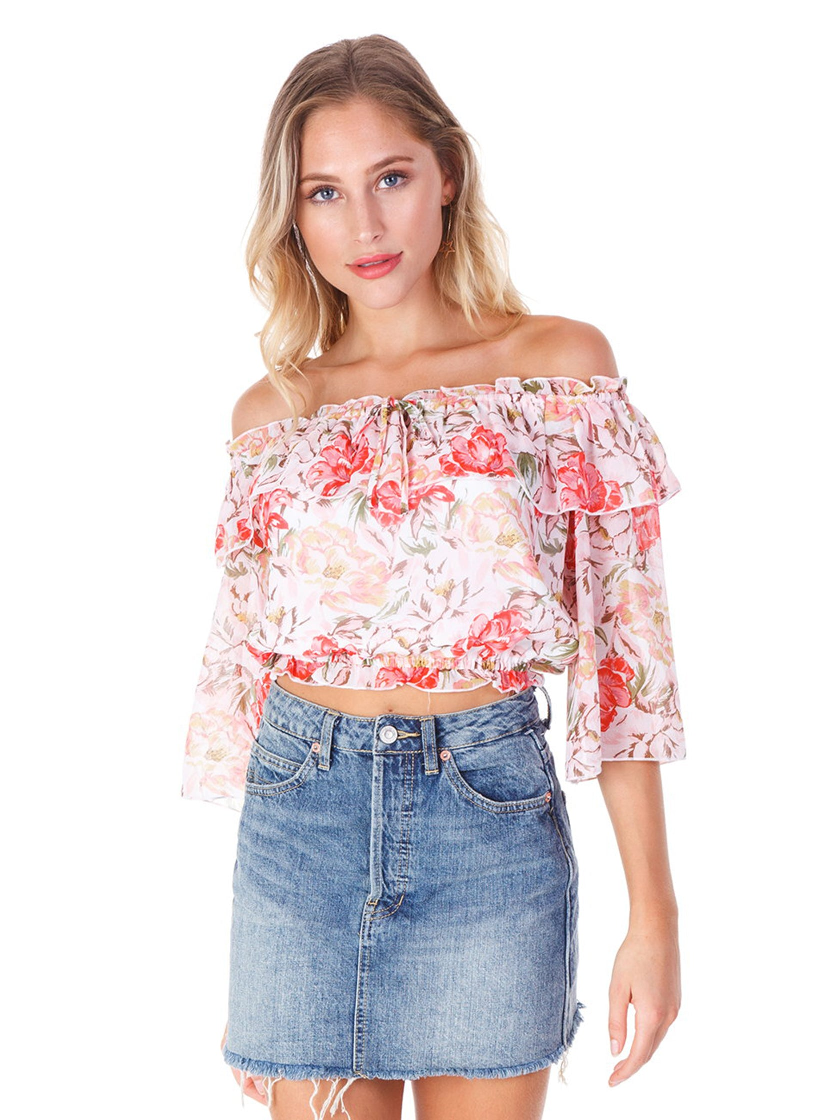 Girl wearing a top rental from WAYF called Cosenza Off Shoulder Crop Top