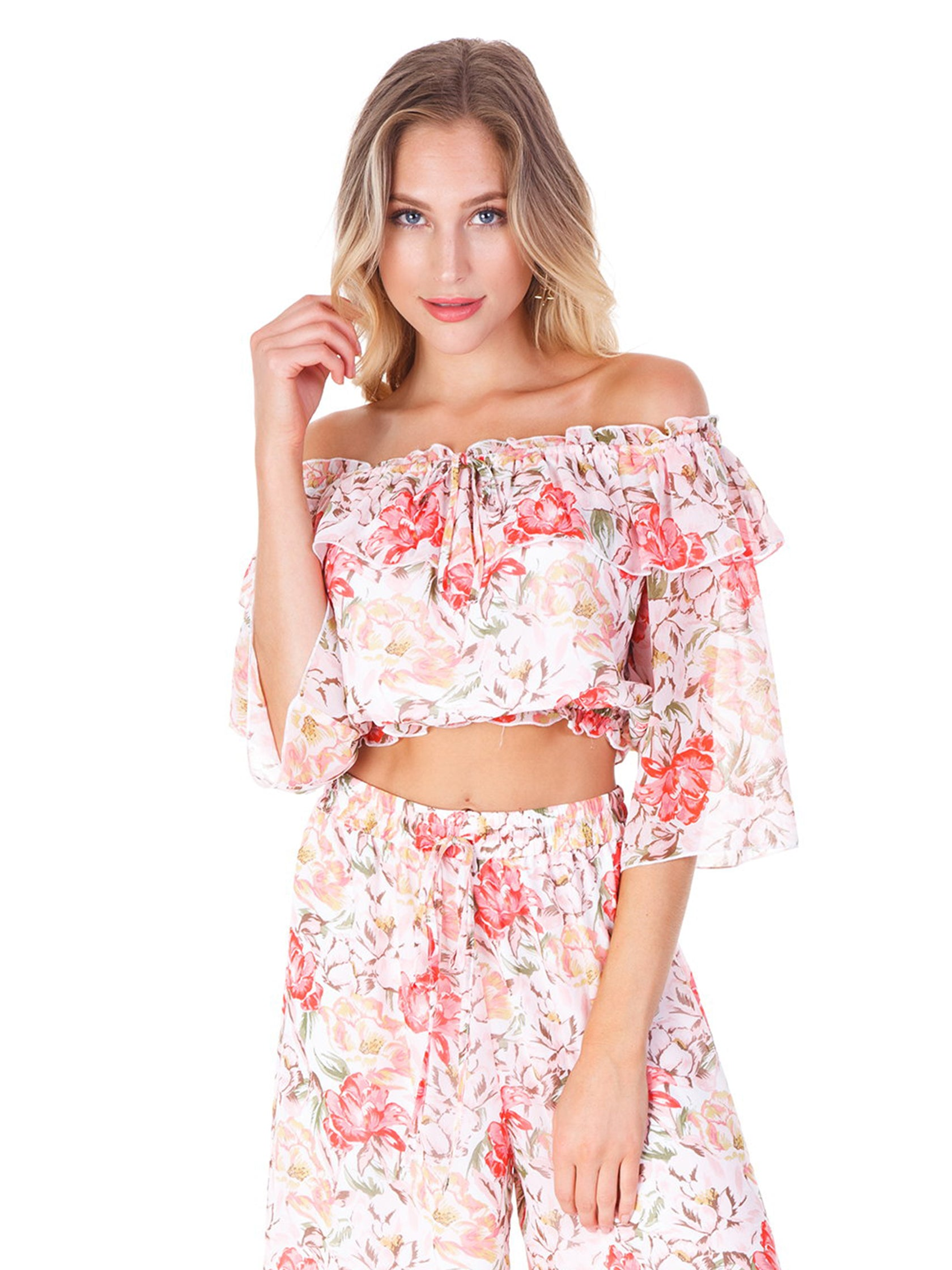 Woman wearing a top rental from WAYF called Cosenza Off Shoulder Crop Top