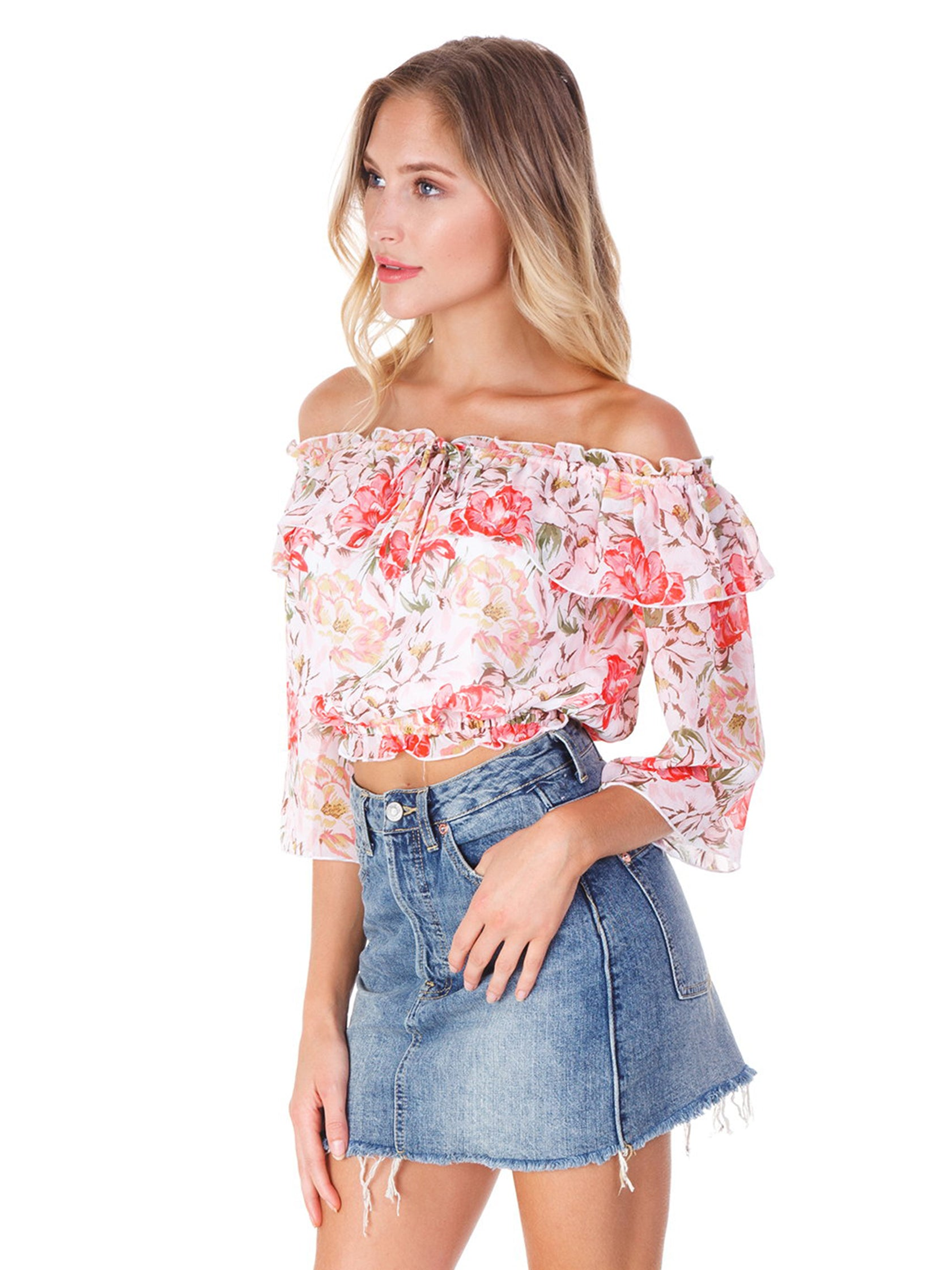 Women wearing a top rental from WAYF called Cosenza Off Shoulder Crop Top
