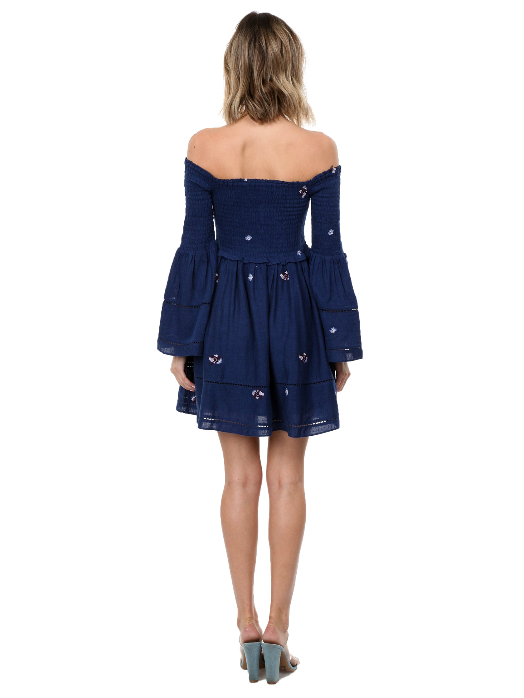 Women wearing a dress rental from Free People called Counting Daisies Embroidered Off The Shoulder Dress