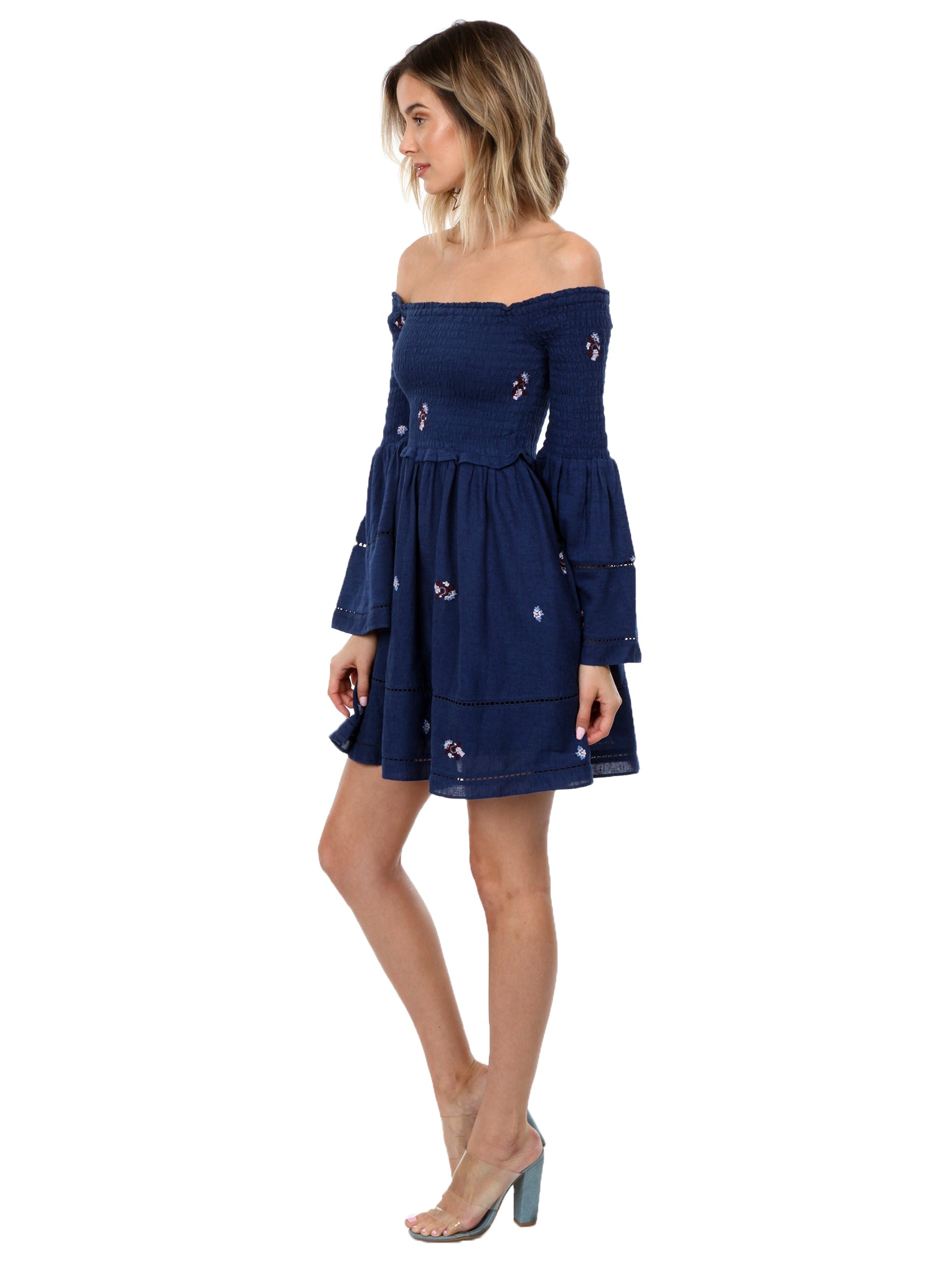 Woman wearing a dress rental from Free People called Counting Daisies Embroidered Off The Shoulder Dress