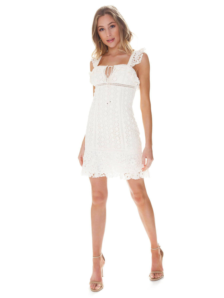 Women outfit in a dress rental from Free People called Ruffle Cold Shoulder Dress
