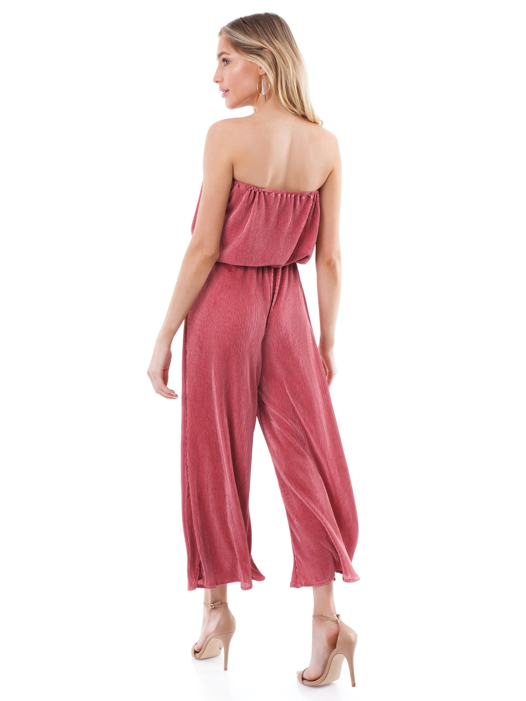 Women wearing a jumpsuit rental from Blue Life called Crystal Pleated Bell Jumper