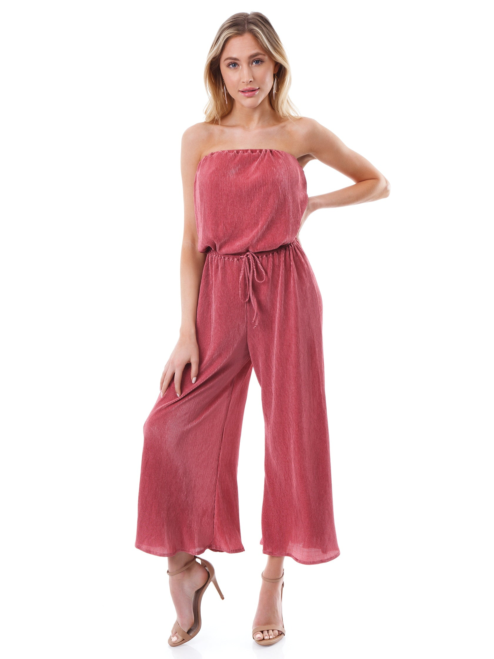 Girl outfit in a jumpsuit rental from Blue Life called Crystal Pleated Bell Jumper