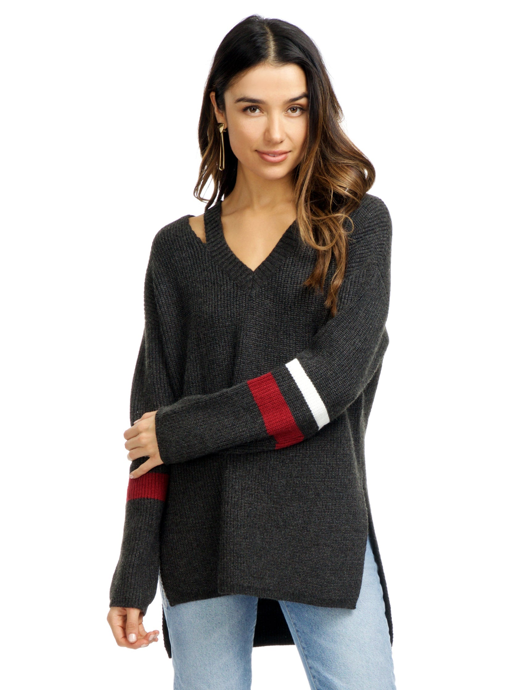 Woman wearing a sweater rental from Strut & Bolt called Cutout Stripe Sweater
