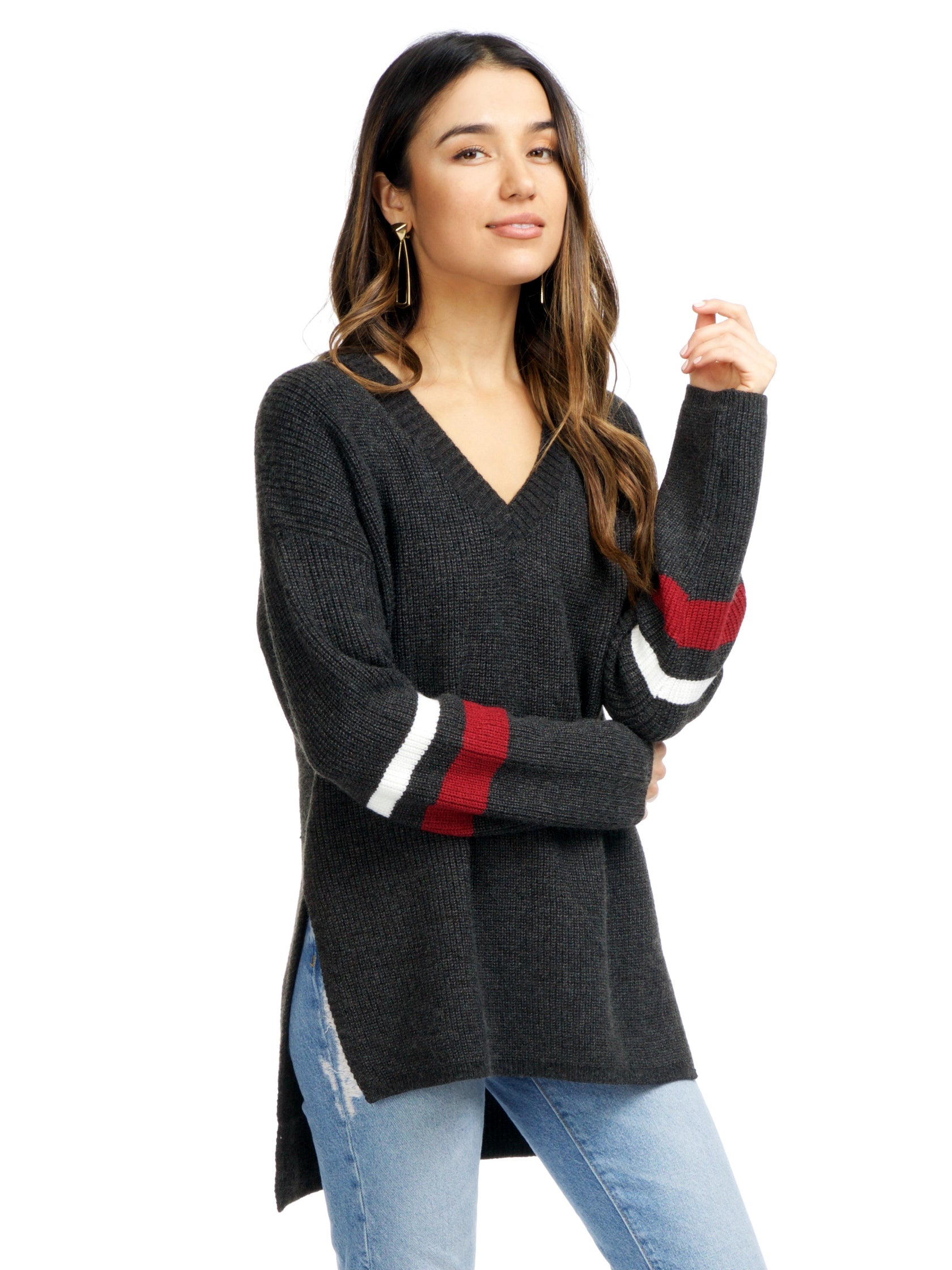 Women wearing a sweater rental from Strut & Bolt called Cutout Stripe Sweater